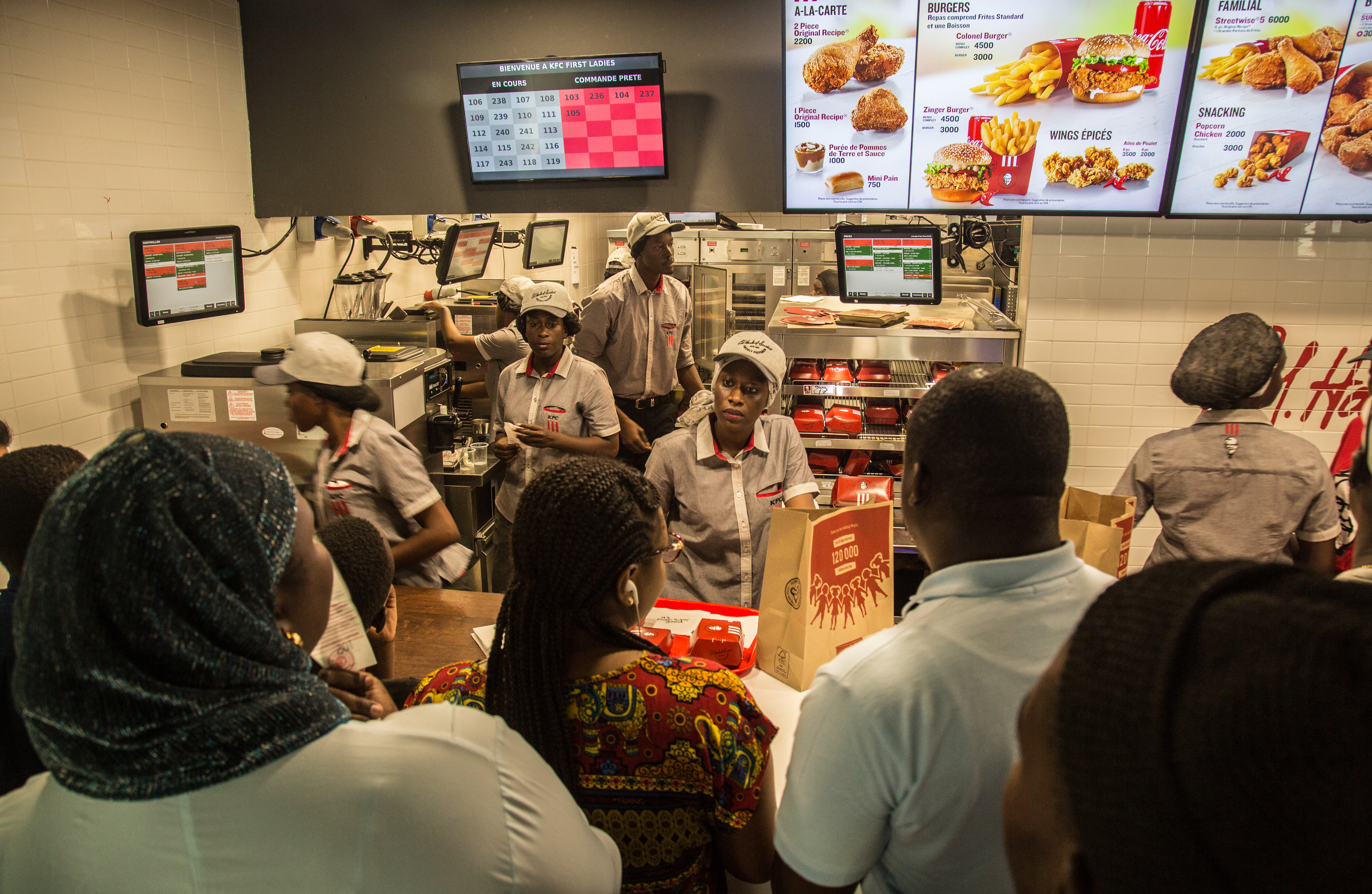 Staff members attend to customers in the new KFC location in Dakar, Senegal, on Oct. 24. MUST CREDIT: Photo for The Washington Post by Yagazie Emezi