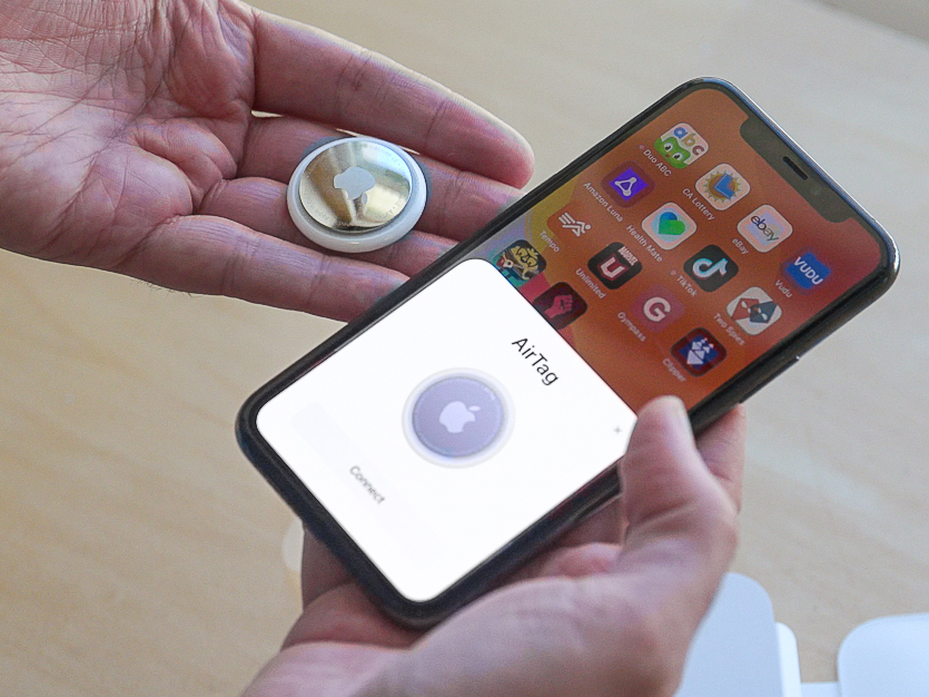 An AirTag pairs with its owner's iPhone, which gets secure updates about its whereabouts through the Find My app. MUST CREDIT: Washington Post photo by Jonathan Baran
