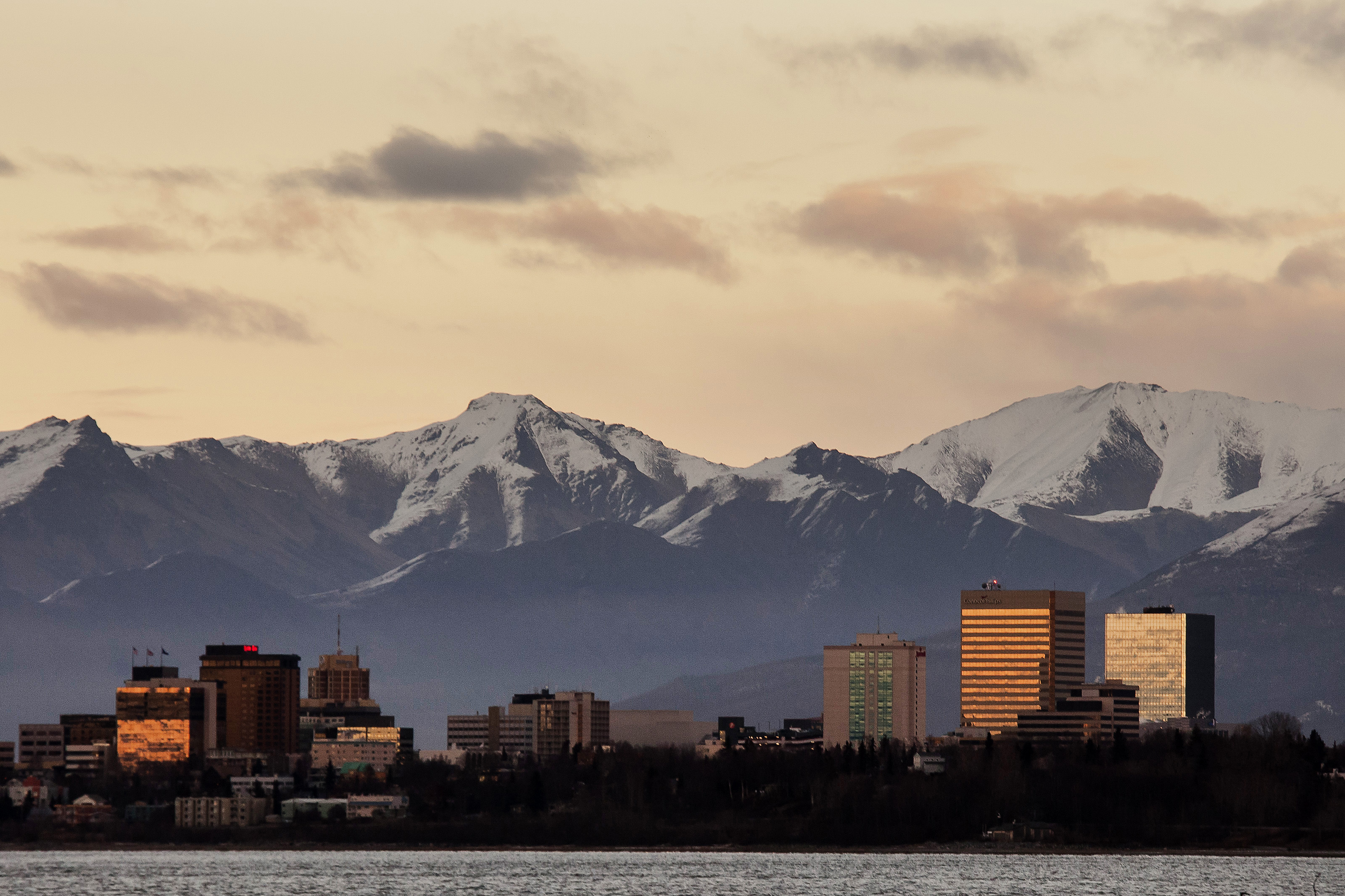 Sunlight reflects off buildings in downtown Anchorage on Nov. 5, 2014. Alaskan cities advertise lifestyle perks to draw new talent. (MUST CREDIT: Bloomberg photo by David Ryder)