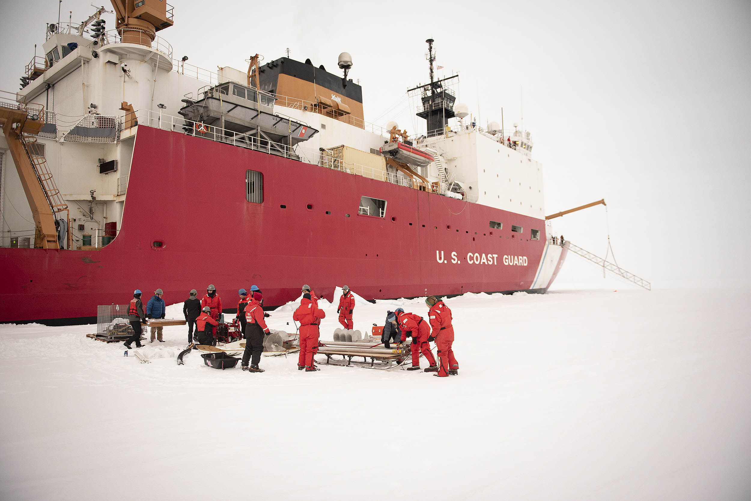 Scientists, engineers and crew members from the U.S. Coast Guard Cutter Healy prepare to unload gear on Oct. 2, 2018, about 715 miles north of Barrow, Alaska, in the Arctic. MUST CREDIT: U.S. Coast Guard photo by Senior Chief Petty Officer NyxoLyno Cangemi