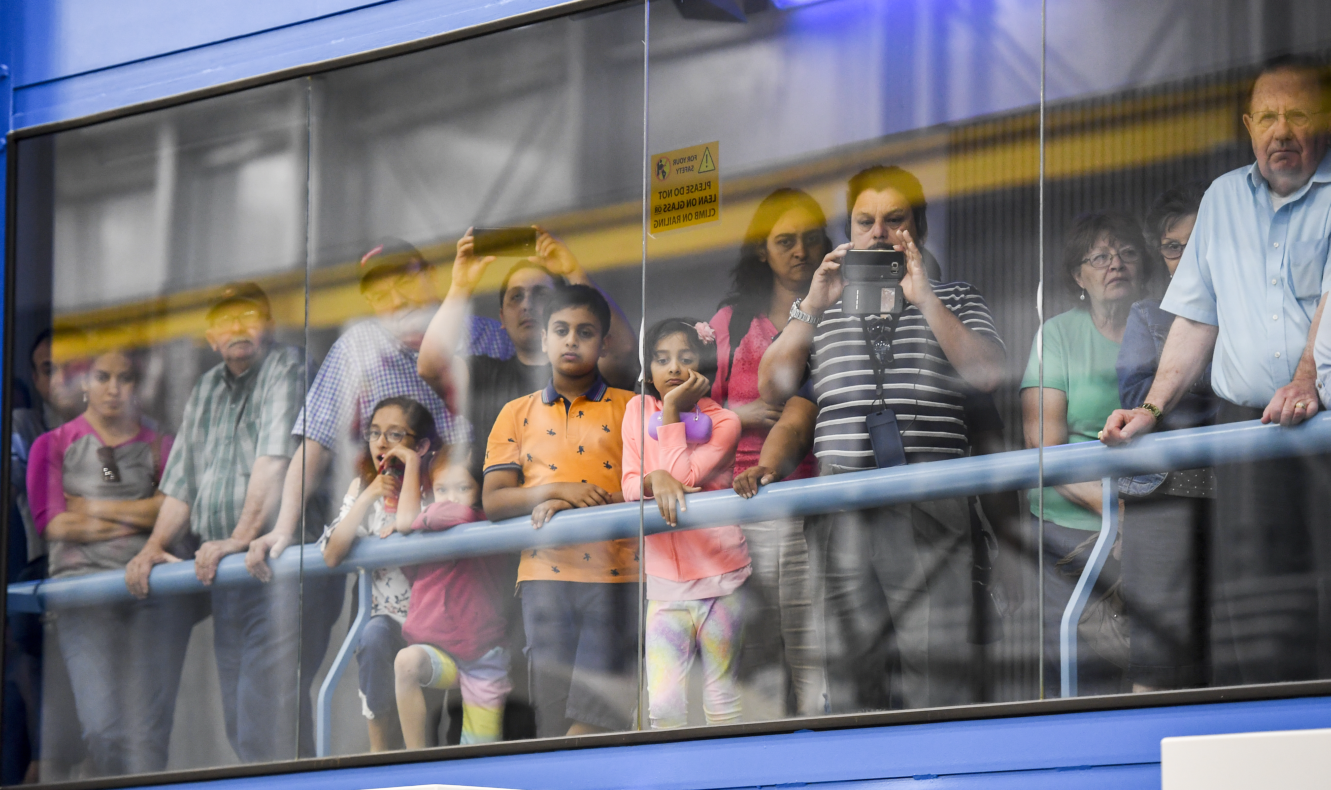 Visitors watch an astronaut practice for flight April 26 at NASA's Johnson Space Center in Houston. Despite the end of shuttle flights, astronauts still travel to the International Space Station. MUST CREDIT: Washington Post photo by Jonathan Newton