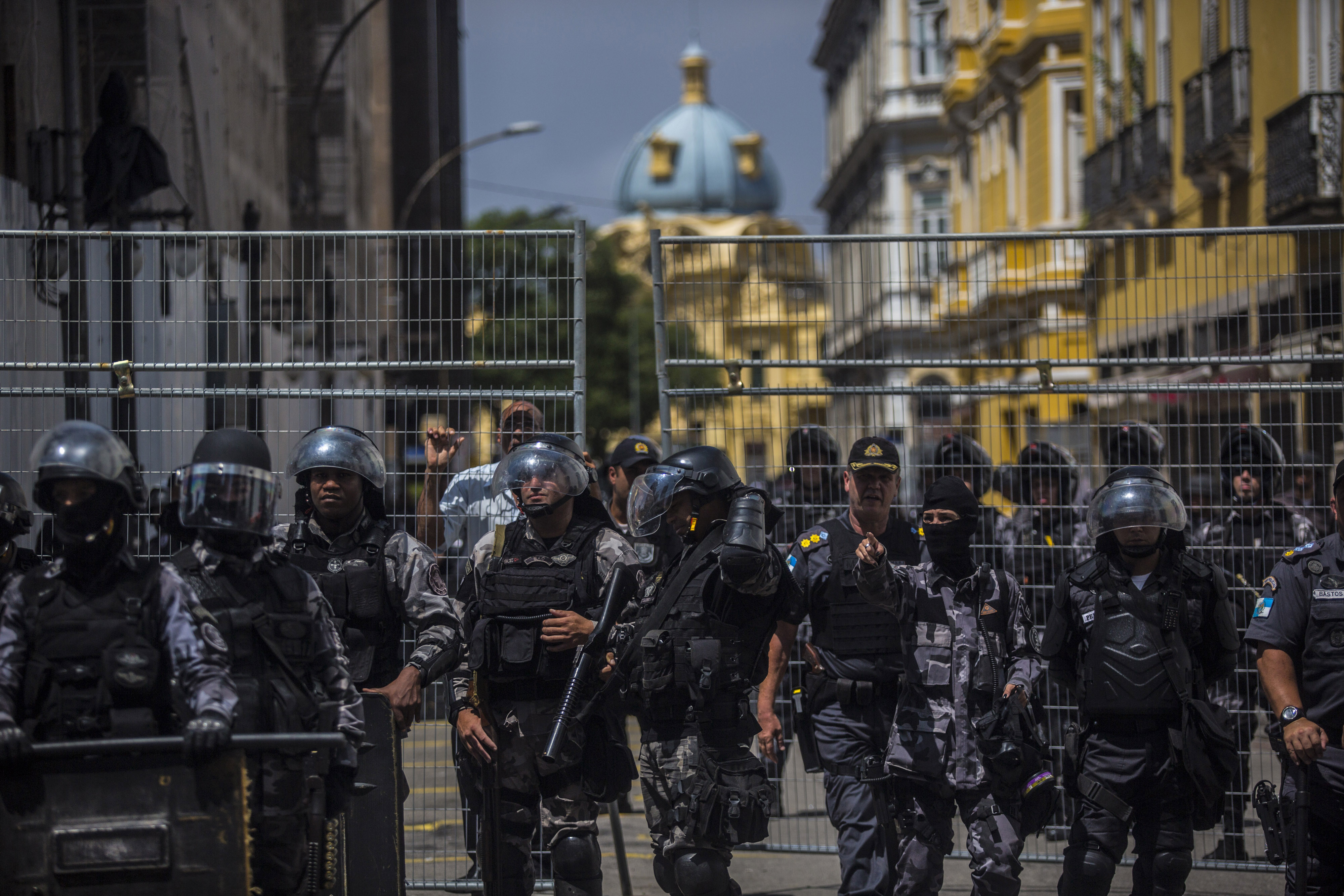 Police officers stand guard during a protest by civil servants outside the Legislative Assembly in Rio de Janeiro on Nov. 16, 2016. MUST CREDIT: Bloomberg photo by Dado Galdieri.