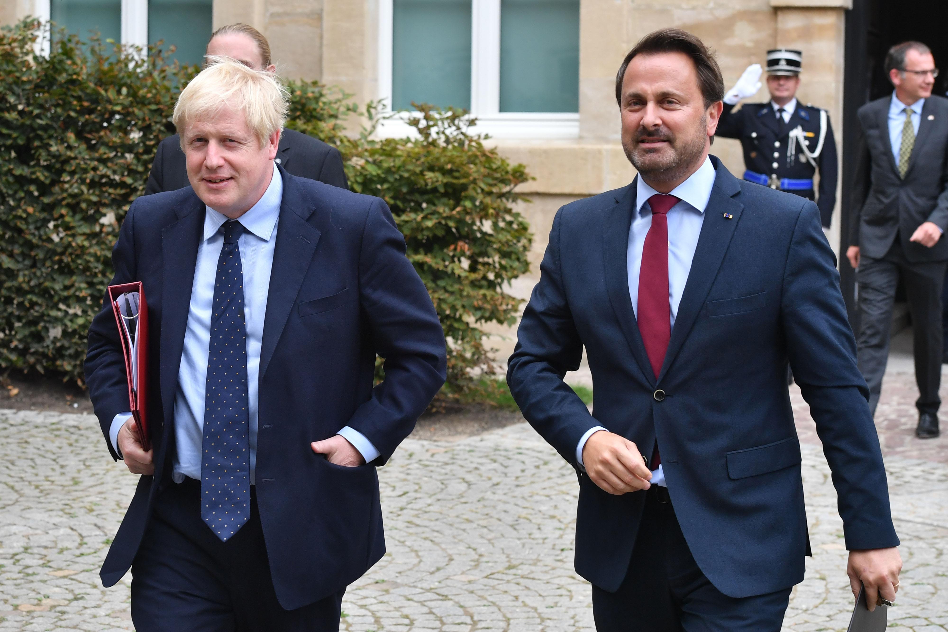 Boris Johnson, U.K. prime minister ( left) departs a Brexit meeting with Xavier Bettel, Luxembourg's prime minister, in Luxembourg, on Sept. 16, 2019. MUST CREDIT: Bloomberg photo by Geert Vanden Wijngaert.