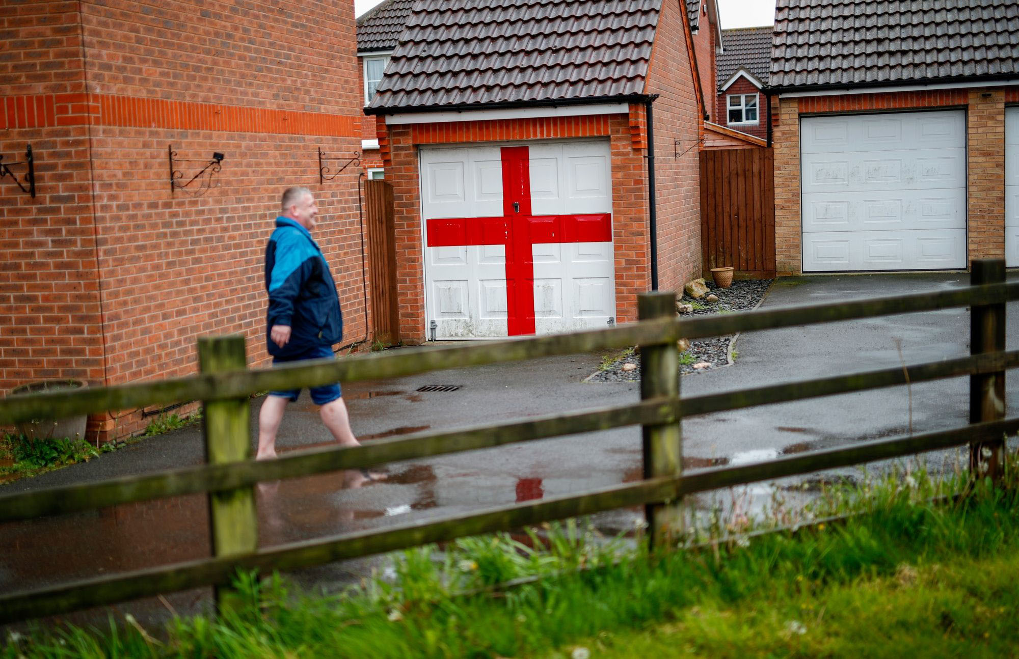 A man walks past a garage decorated with a Saint George's Cross in Holbeach, England, on May 8, 2019. MUST CREDIT: Bloomberg photo by Darren Staples.