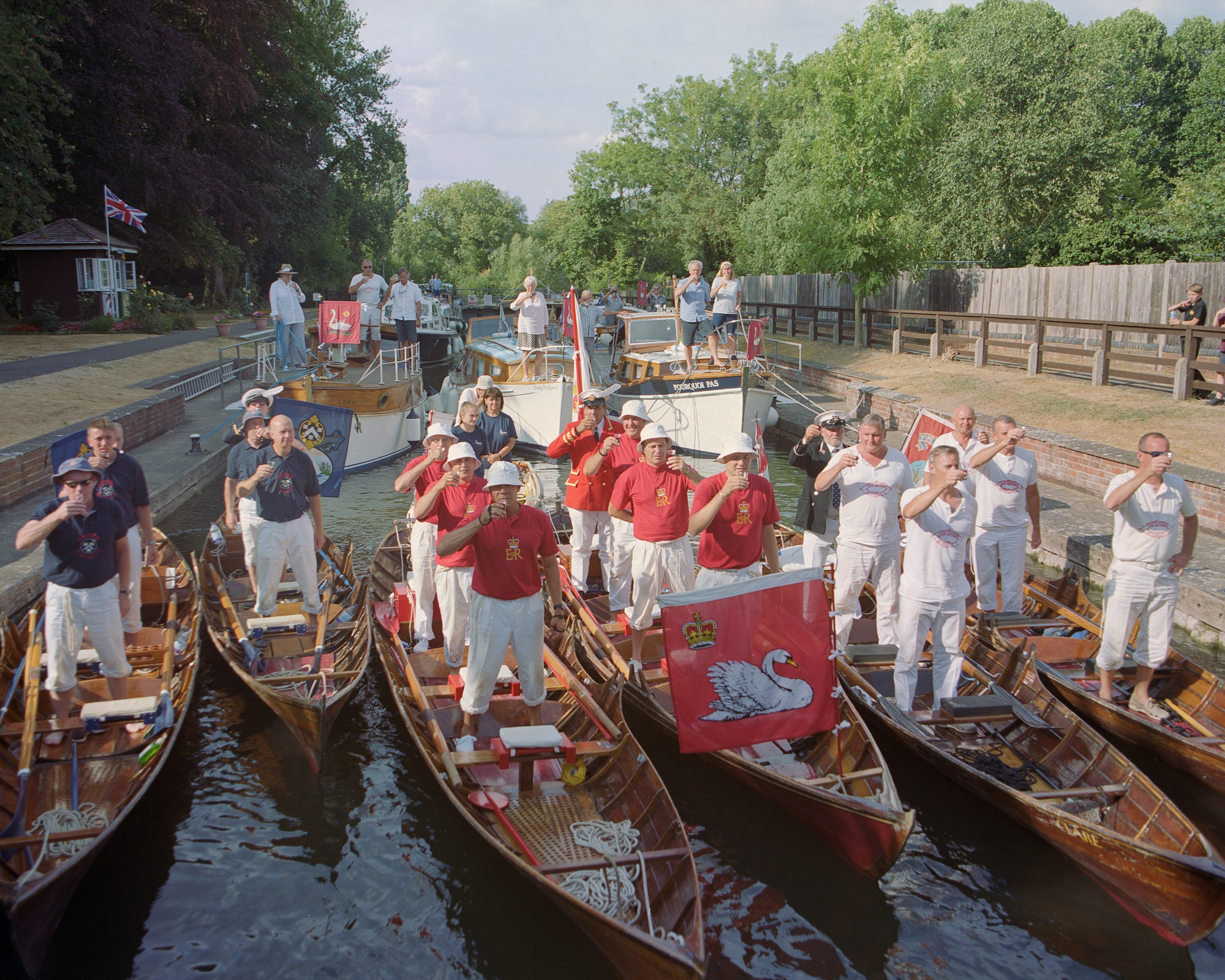 Crews raise a toast to the queen on the first day of Swan Upping in England on July 16, 2018. MUST CREDIT: Photo for The Washington Post by Tori Ferenc