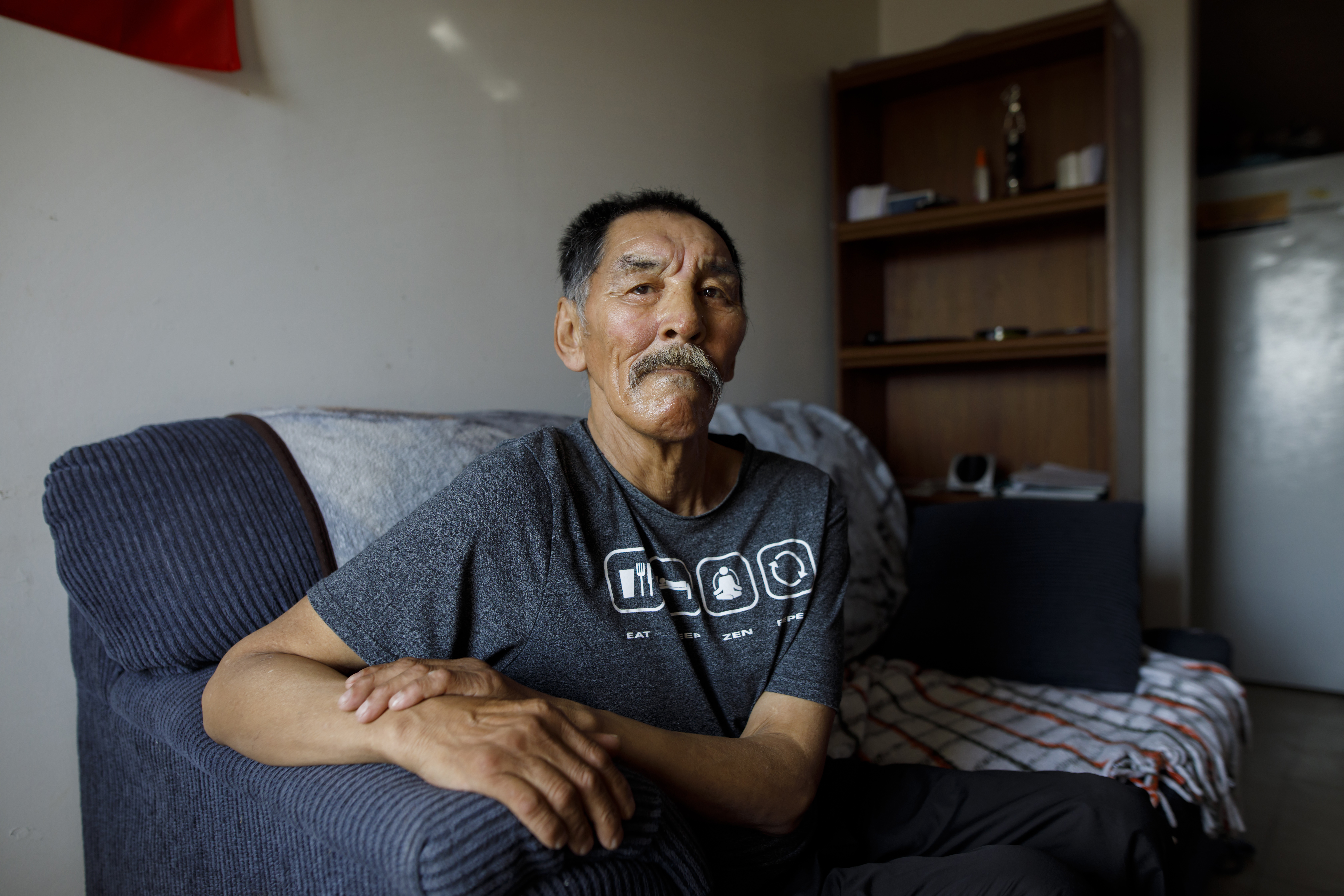 Elder James Kalluk sits for a photograph at his home in Baker Lake, Nunavut, on July 29, 2019. MUST CREDIT: Bloomberg photo by Cole Burston.