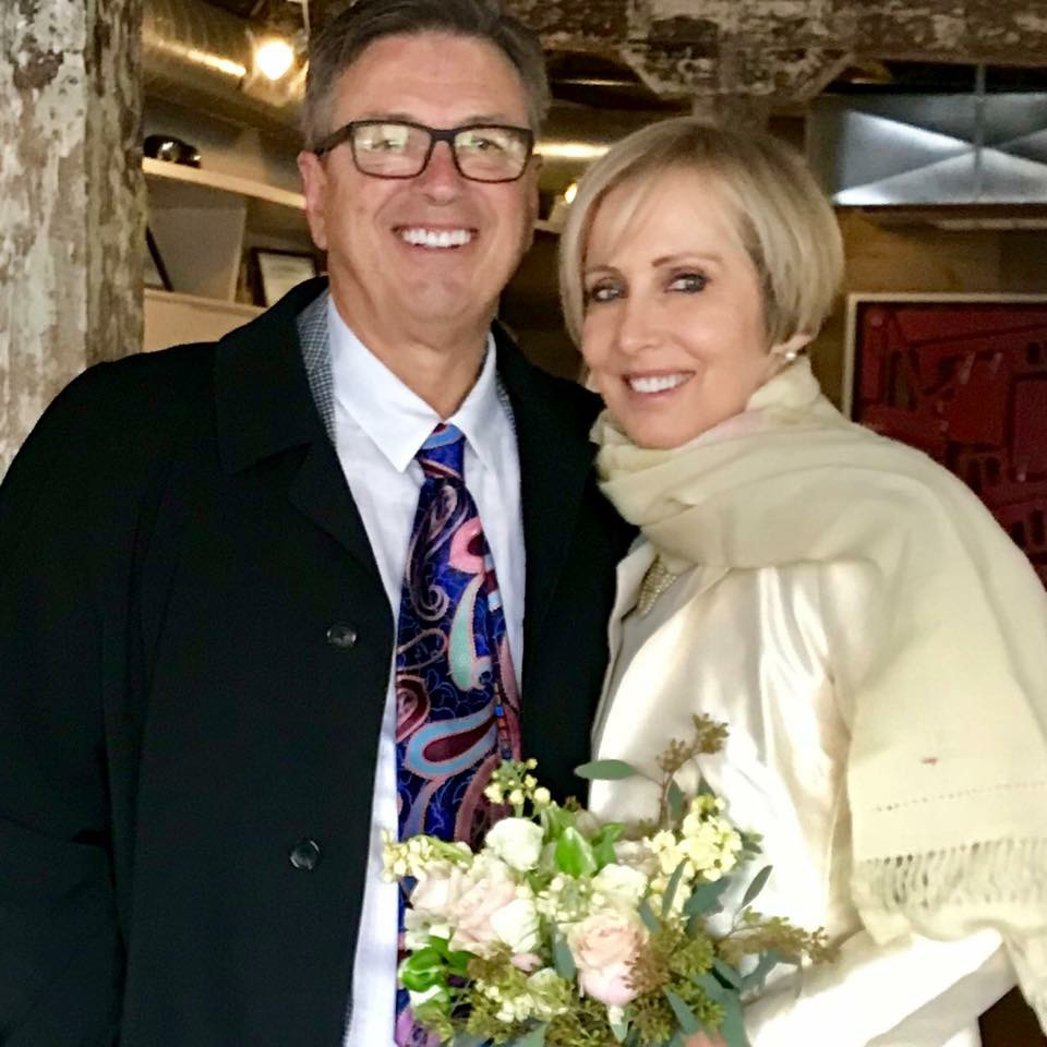 Susan Lisovicz and Lawrence Bijou on their wedding day last November, while she was being treated for advanced ovarian cancer. MUST CREDIT: Courtesy of Jessica Gaber