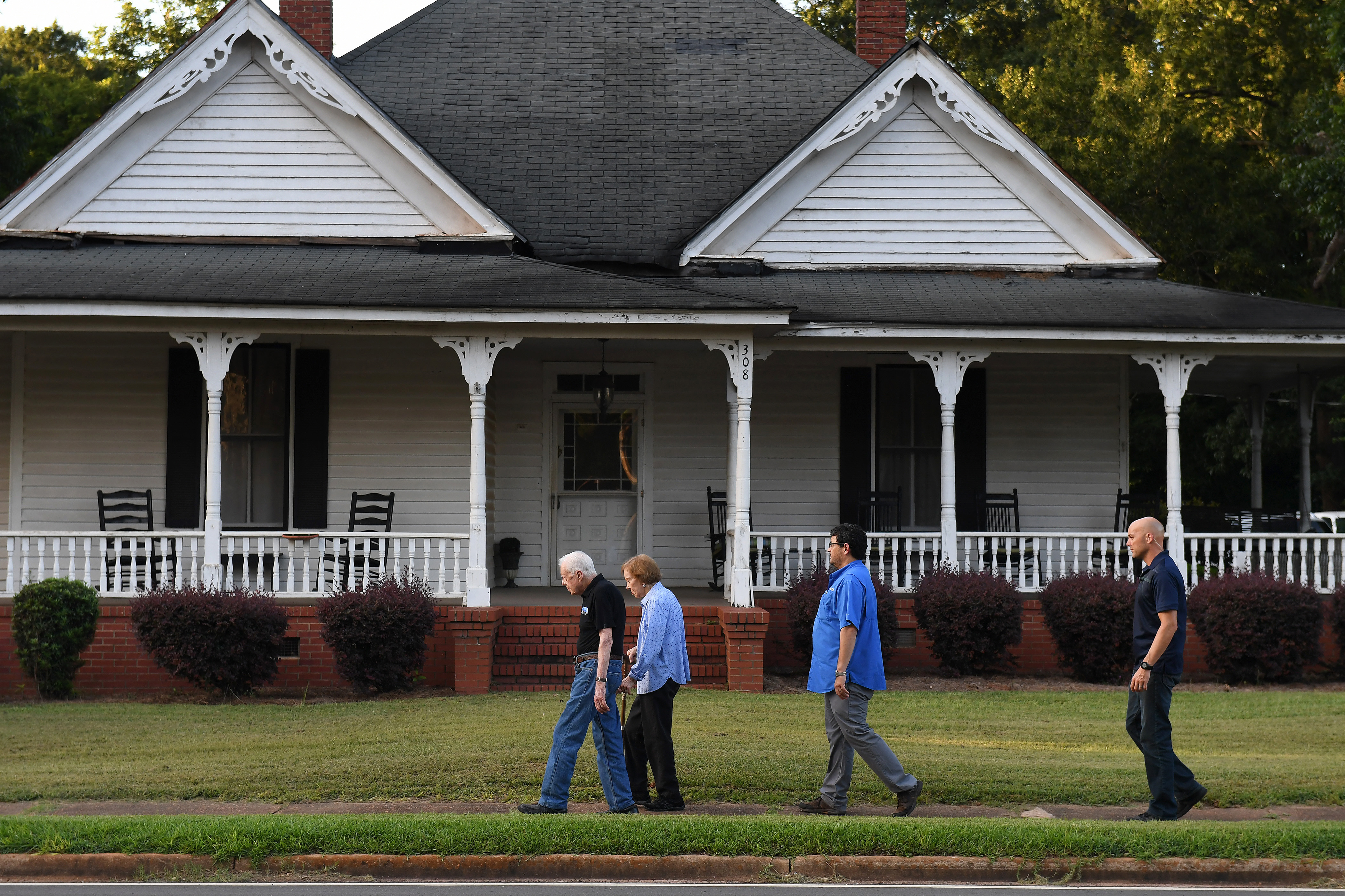Jimmy and Rosalynn Carter walk home with Secret Service agents along West Church Street after having dinner at a friend's house in Plains, Ga., their hometown. MUST CREDIT: Washington Post photo by Matt McClain