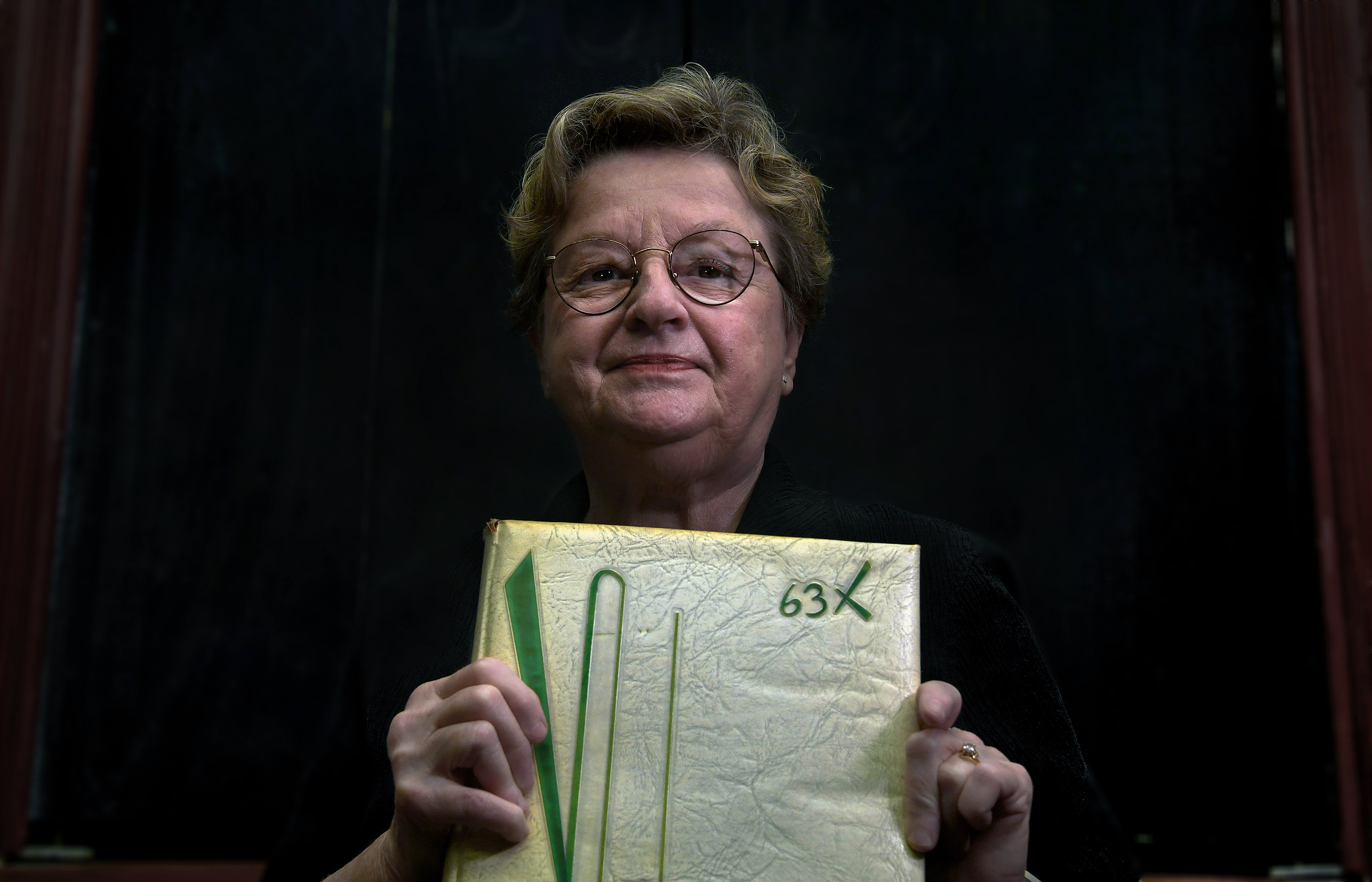 Joan Levin (holding her 1960 high school yearbook) was part of a large aptitude study in 1960 called Project Talent. MUST CREDIT: Washington Post photo by Michael S. Williamson
