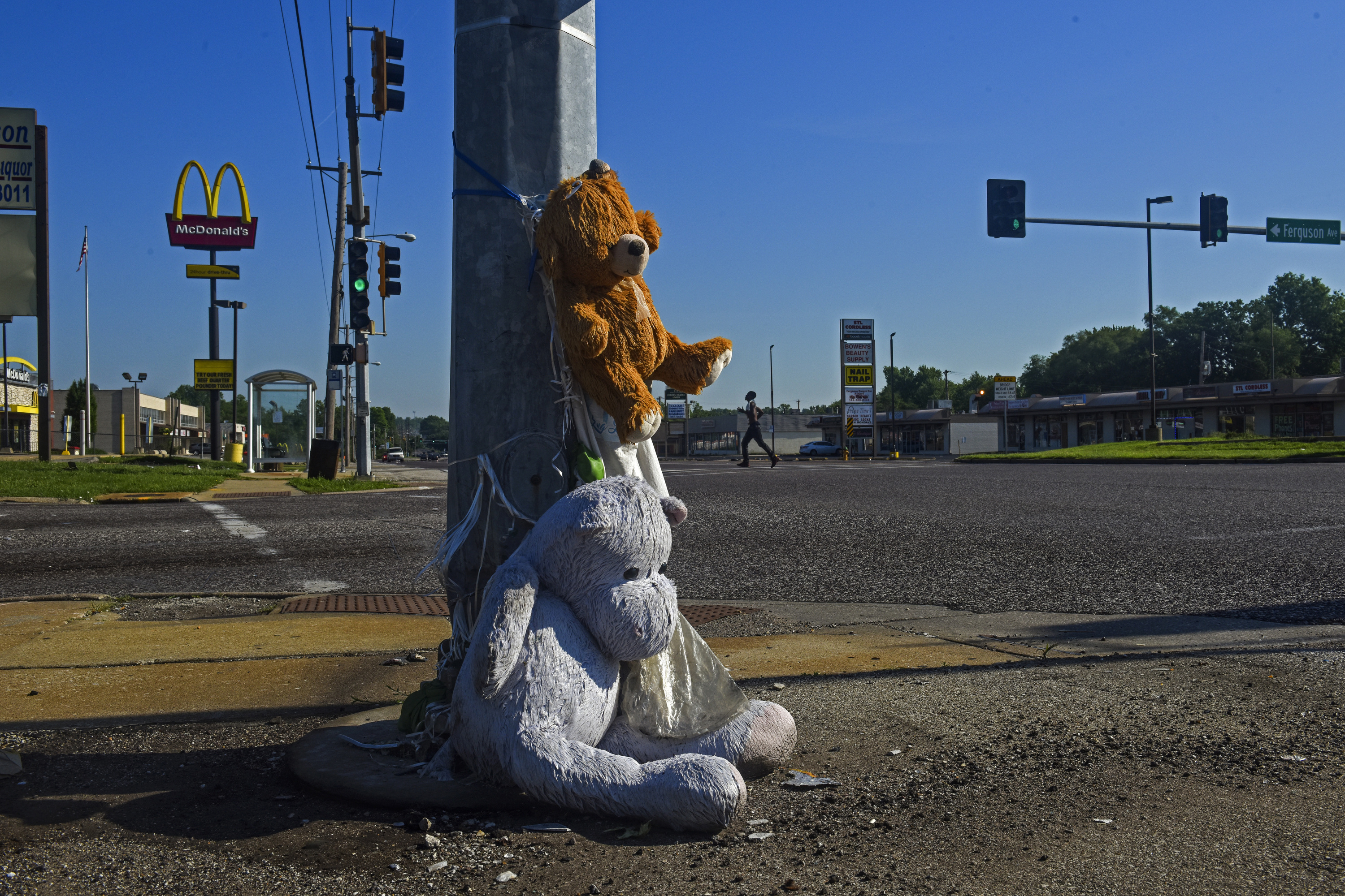 A weathered memorial sits at the corner of West Florissant and Ferguson avenues on May 28 in Ferguson. MUST CREDIT: Washington Post photo by Jahi Chikwendiu.