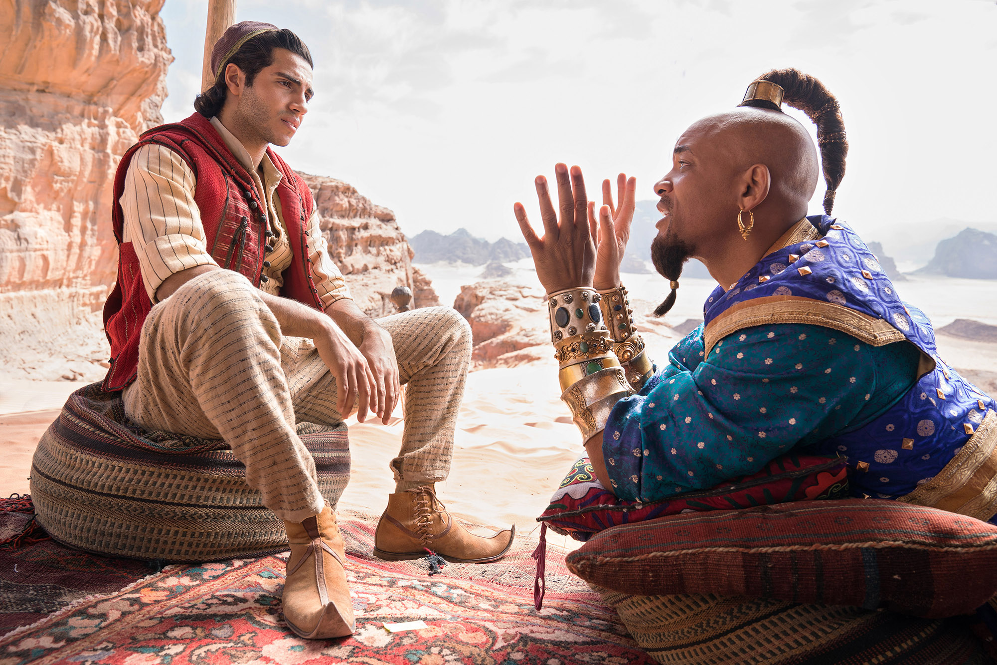 (L-r) Mena Massoud and Will Smith in