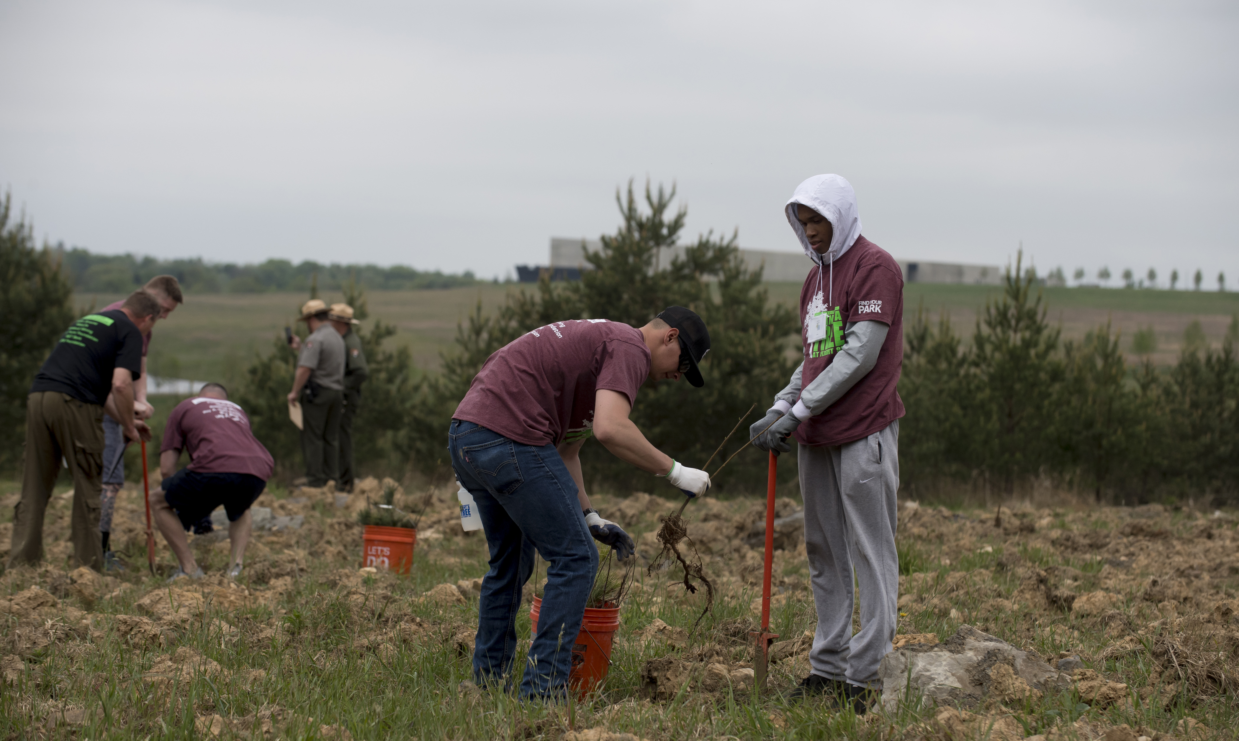 Volunteers plant trees Saturday at the site where Flight 93 crashed in Somerset County, Pennsylvania, during the 9/11 terrorist attacks. The