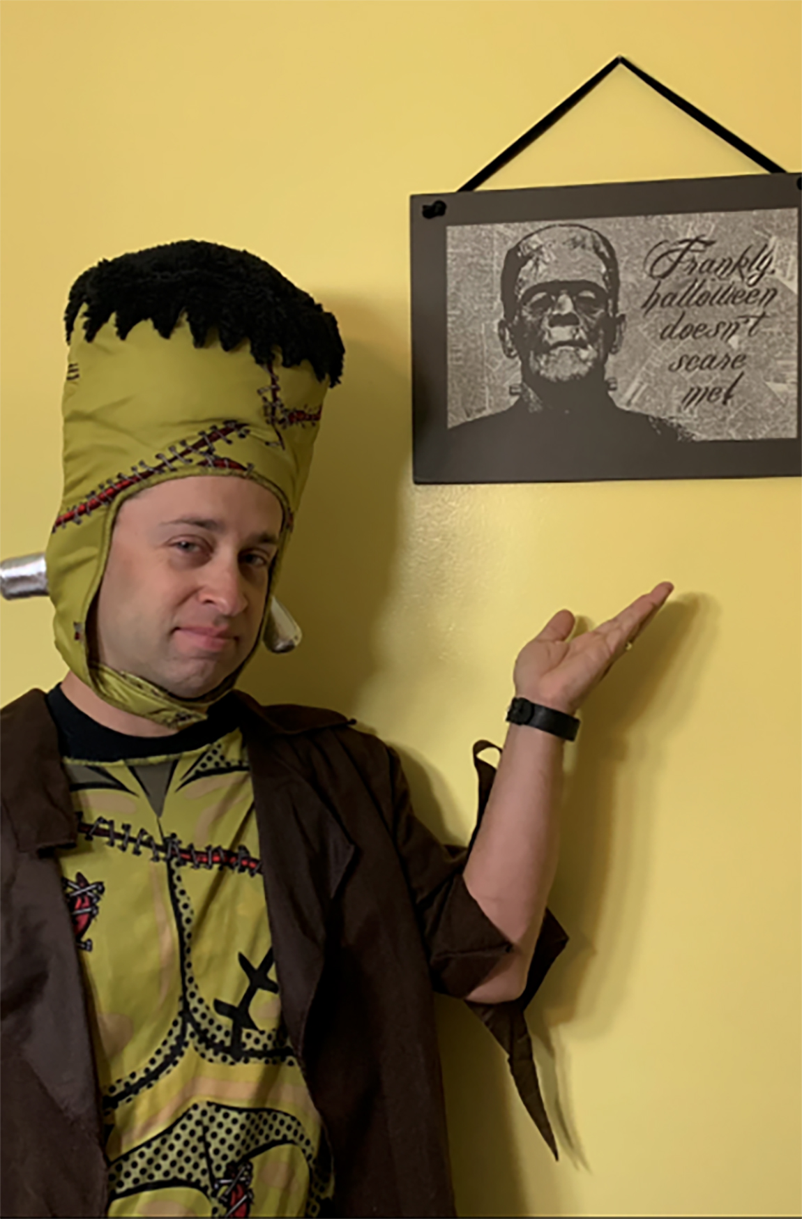 Jeff Frankenstein shows off his Frankenstein costume and his decorative Frankenstein sign at his Pennsylvania home. MUST CREDIT: Jeff Frankenstein.