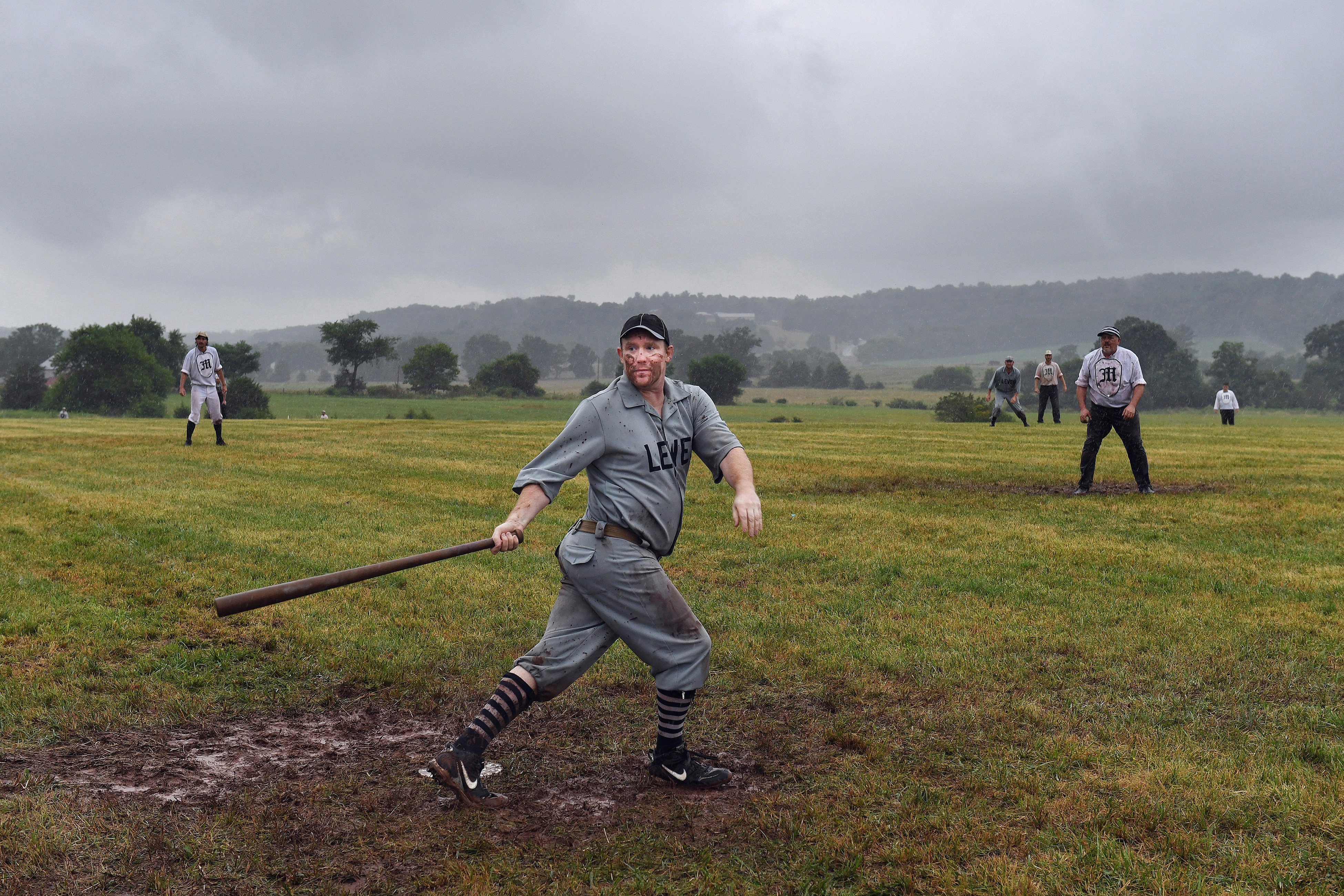 Steve Scharff, 36, of the Lewes Base Ball Club takes part in the National 19th Century Base Ball Festival on Saturday in Gettysburg, Pa. The game is played by 1863 rules: players wear vintage uniforms and catch the ball with their bare hands. The tournament was supposed to continue Sunday but was rained out. MUST CREDIT: Washington Post photo by Matt McClain