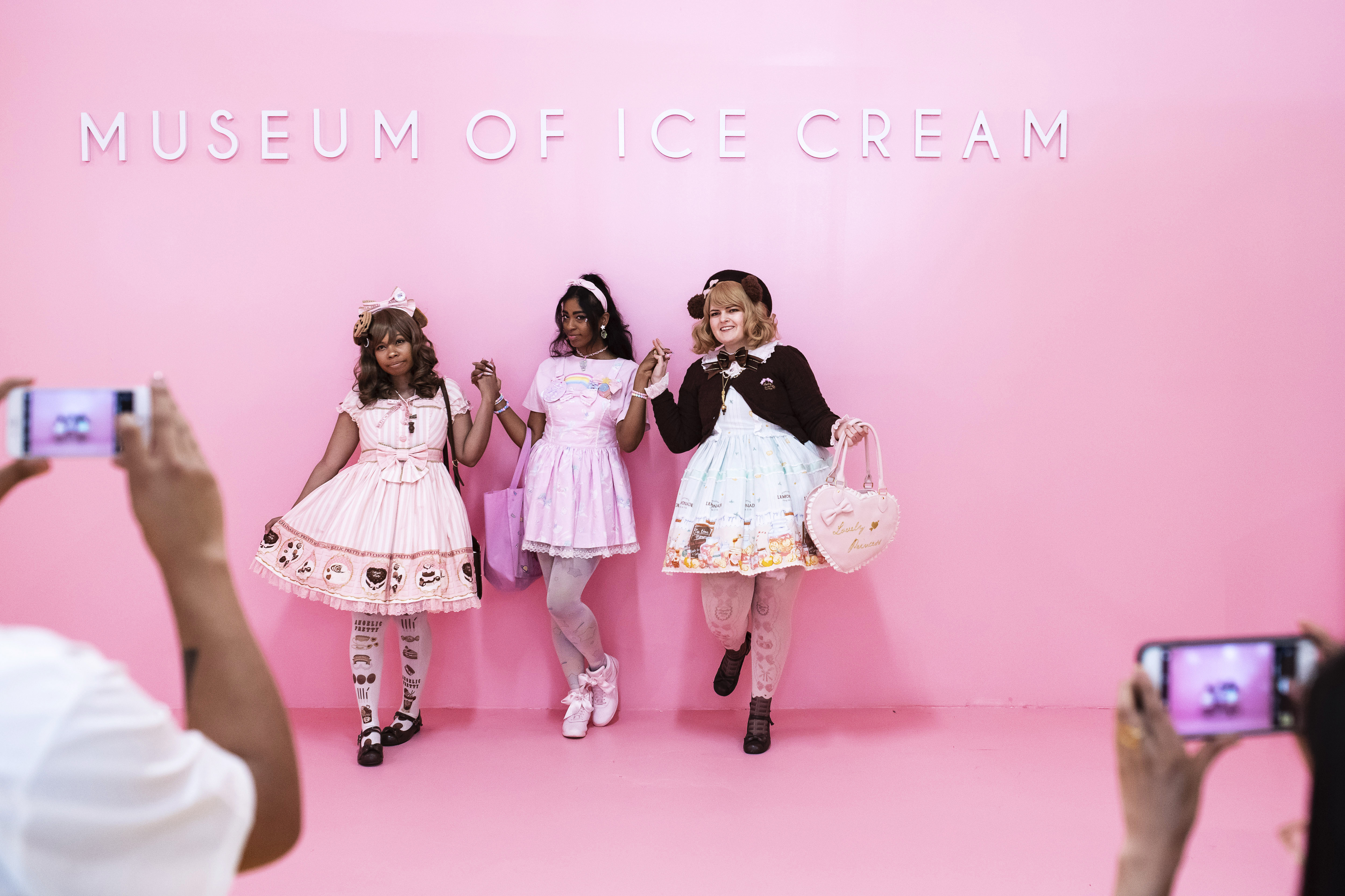 From left, Christina Morris, Tanaya Torres and Tara Hayes pose for photos at the Museum of Ice Cream's Pint Shop. MUST CREDIT: Photo by Karsten Moran for The Washington Post.