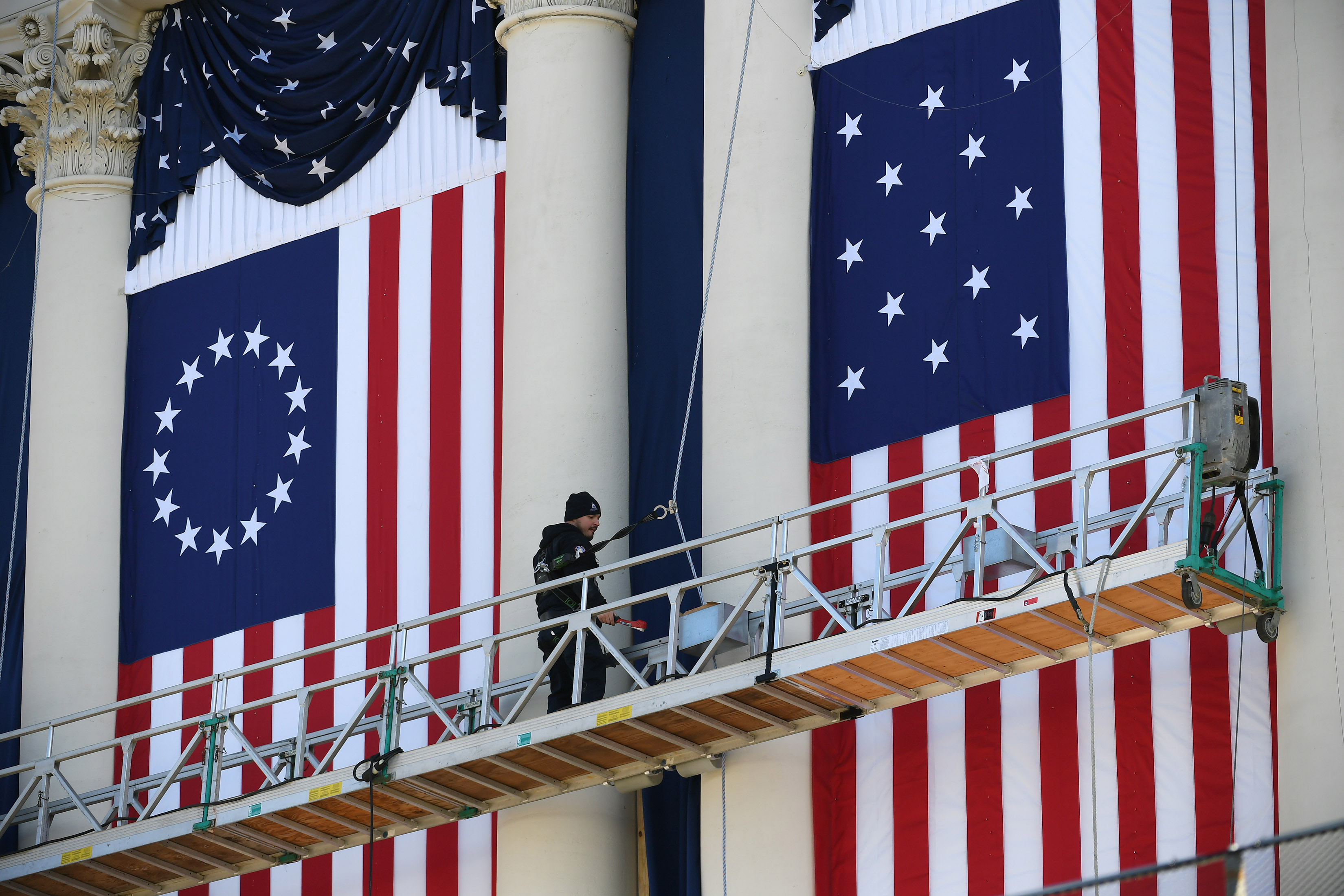 A worker prepares for Donald Trump's presidential inauguration at the U.S. Capitol during a rehearsal on Sunday. MUST CREDIT: Washington Post photo by Matt McClain