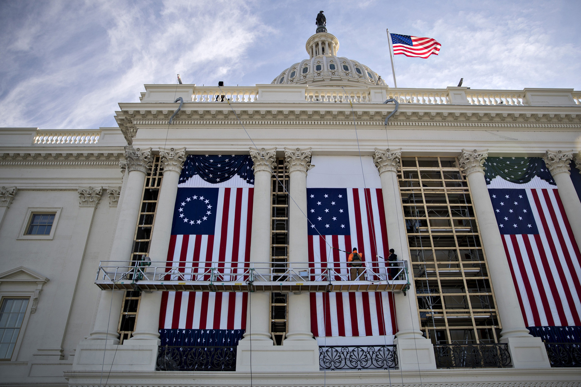 Workers adjust an American flag at the U.S. Capitol building during rehearsal for the 2017 Inaugural Ceremonies in Washington on Jan. 15, 2017. MUST CREDIT: Bloomberg photo by Andrew Harrer.