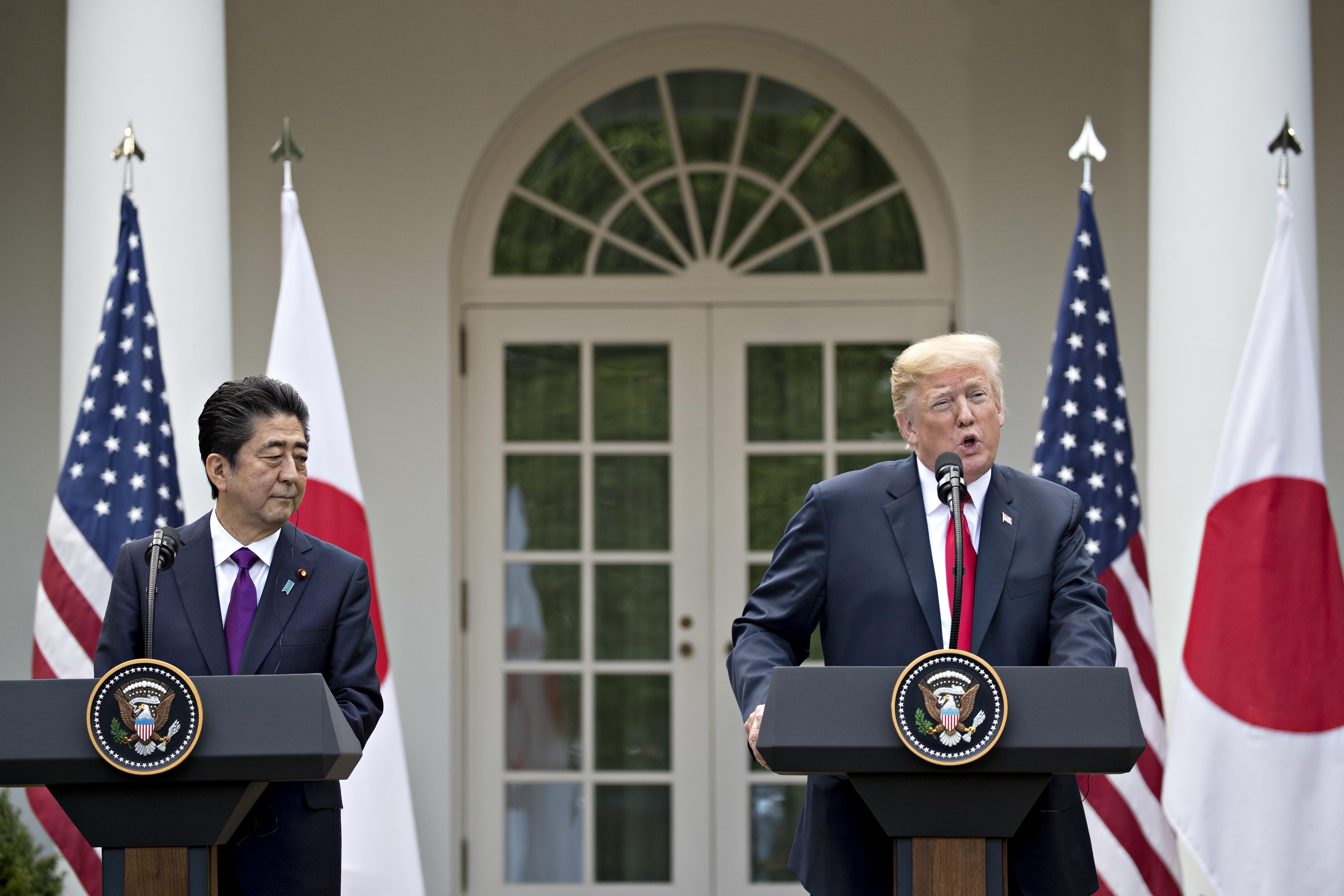President Donald Trump speaks as Shinzo Abe, Japan's prime minister, left, listens in the Rose Garden of the White House in Washington on June 7, 2018. MUST CREDIT: Bloomberg photo by Andrew Harrer.