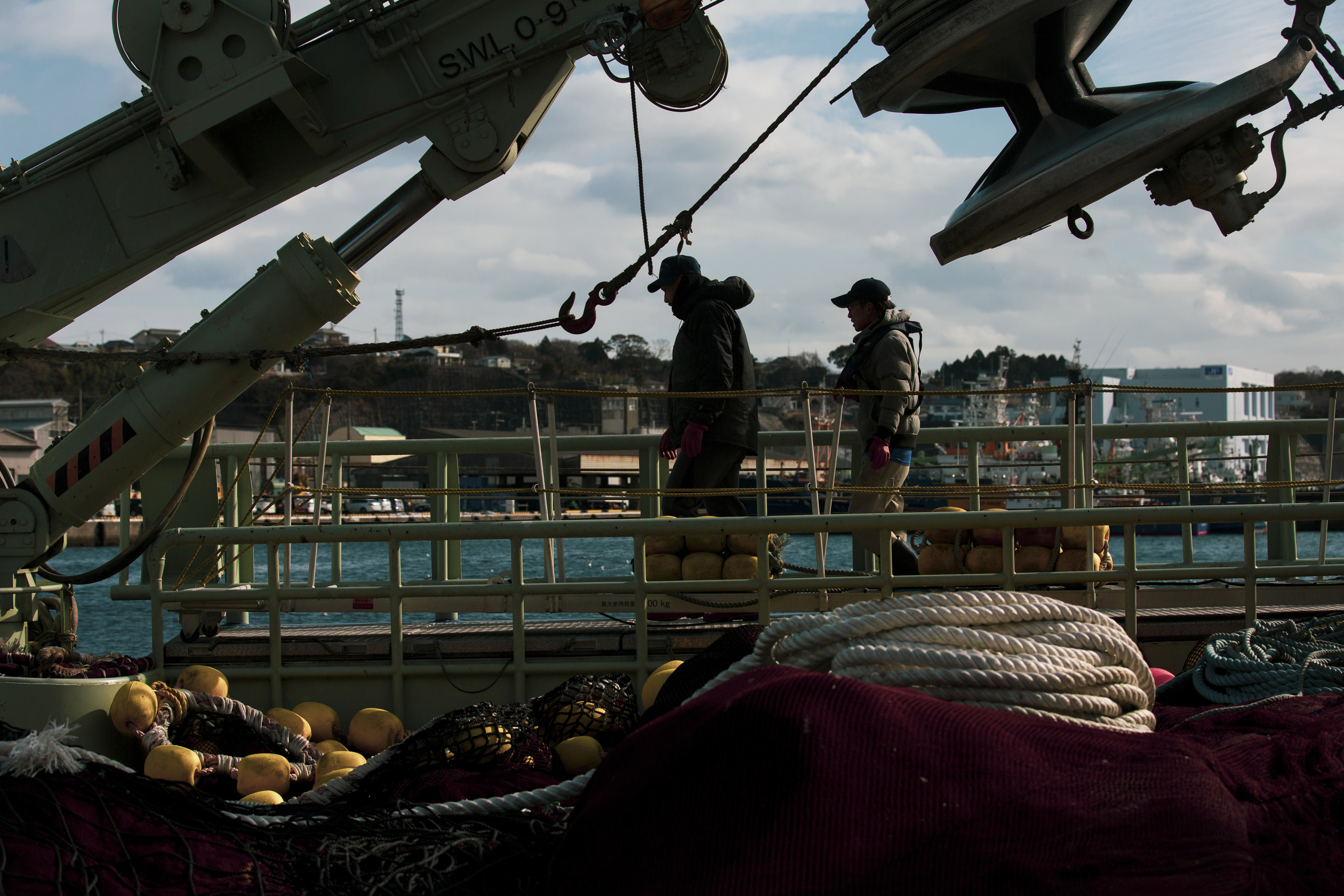 Fishermen leave a fishing boat at the port of Onahama in Iwaki, Japan. MUST CREDIT: photo for The Washington Post by Shiho Fukada.