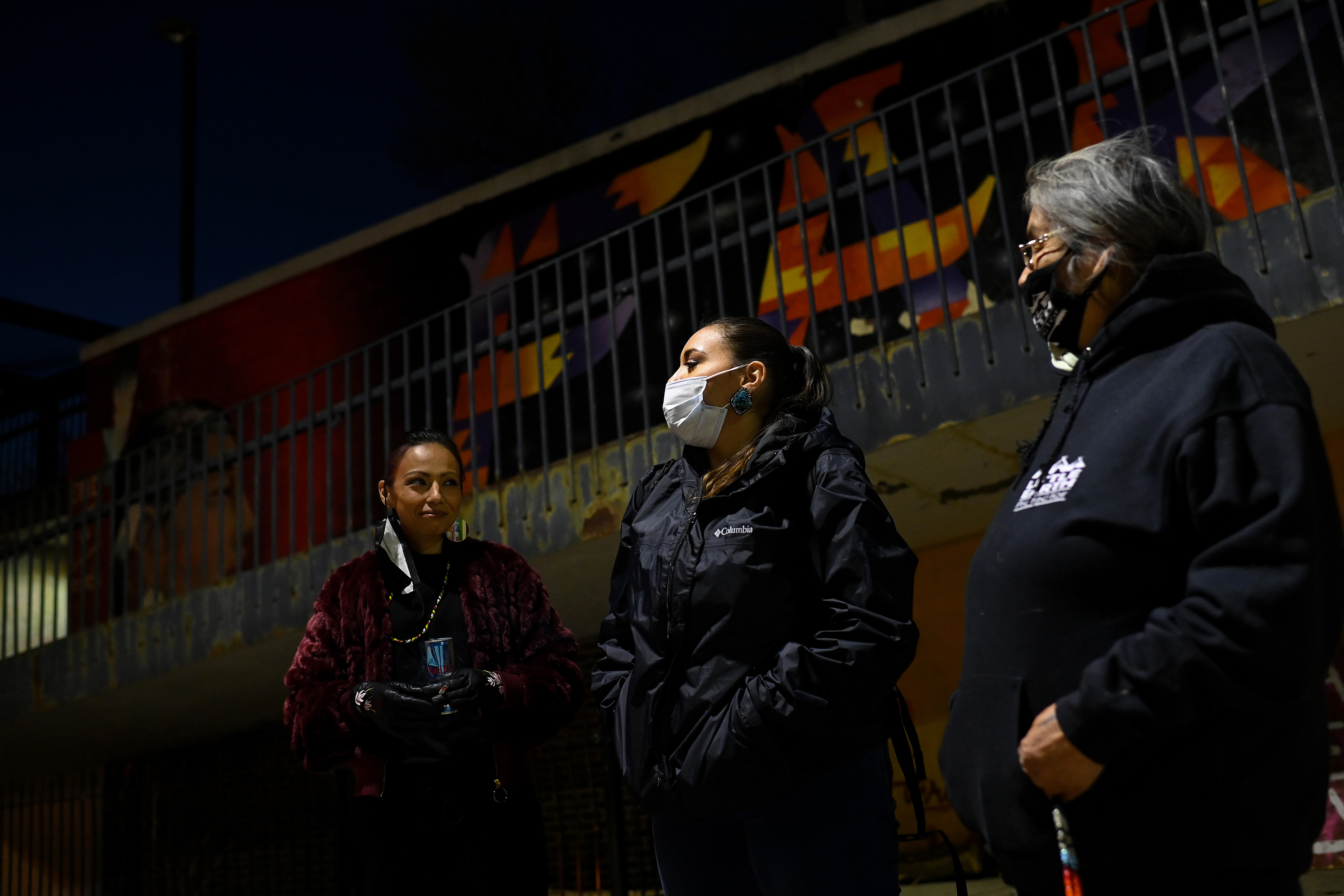 Margarita Ortega, center, talks with other members of the Little Earth Protectors as they patrol. MUST CREDIT: Washington Post photo by Joshua Lott