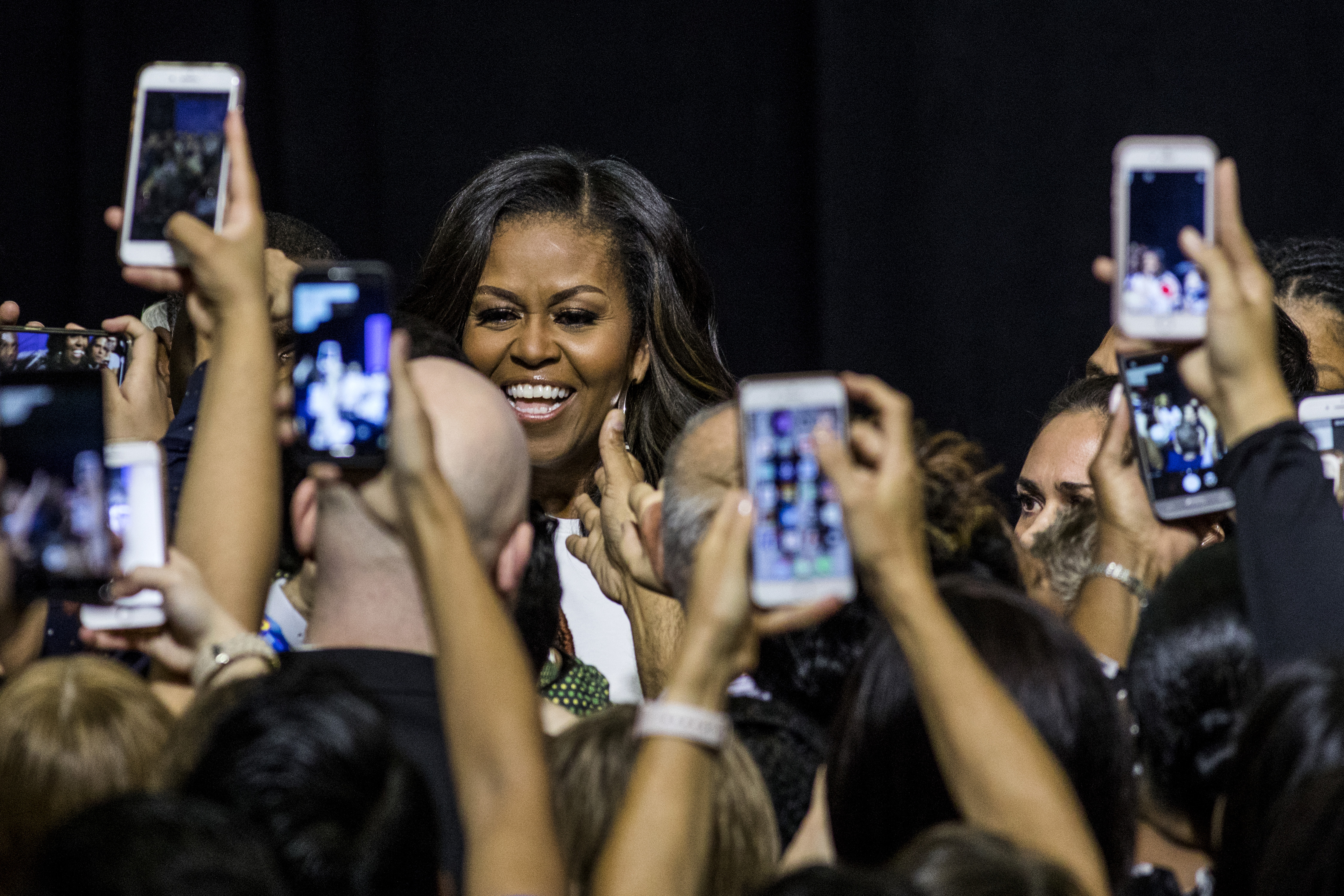Former first lady Michelle Obama prepares to take the stage during a When We All Vote rally at Chaparral High School in Las Vegas. Obama, the founder and co-chairwoman of the organization, spoke at the September rally with over 2,000 volunteers and eligible voters present. MUST CREDIT: Photo for The Washington Post by Joe Buglewicz