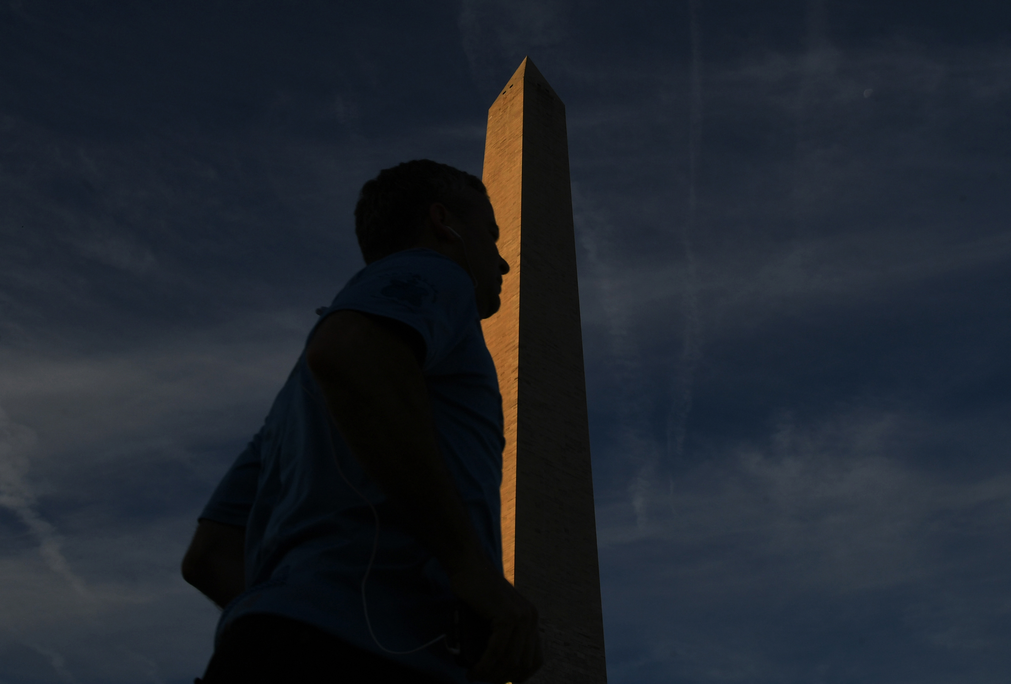 A pedestrian walks by the Washington Monument before the iconic structure's reopenining to the public on Thursday, Sept. 19, 2019, in Washington. MUST CREDIT: Washington Post photo by Matt McClain.