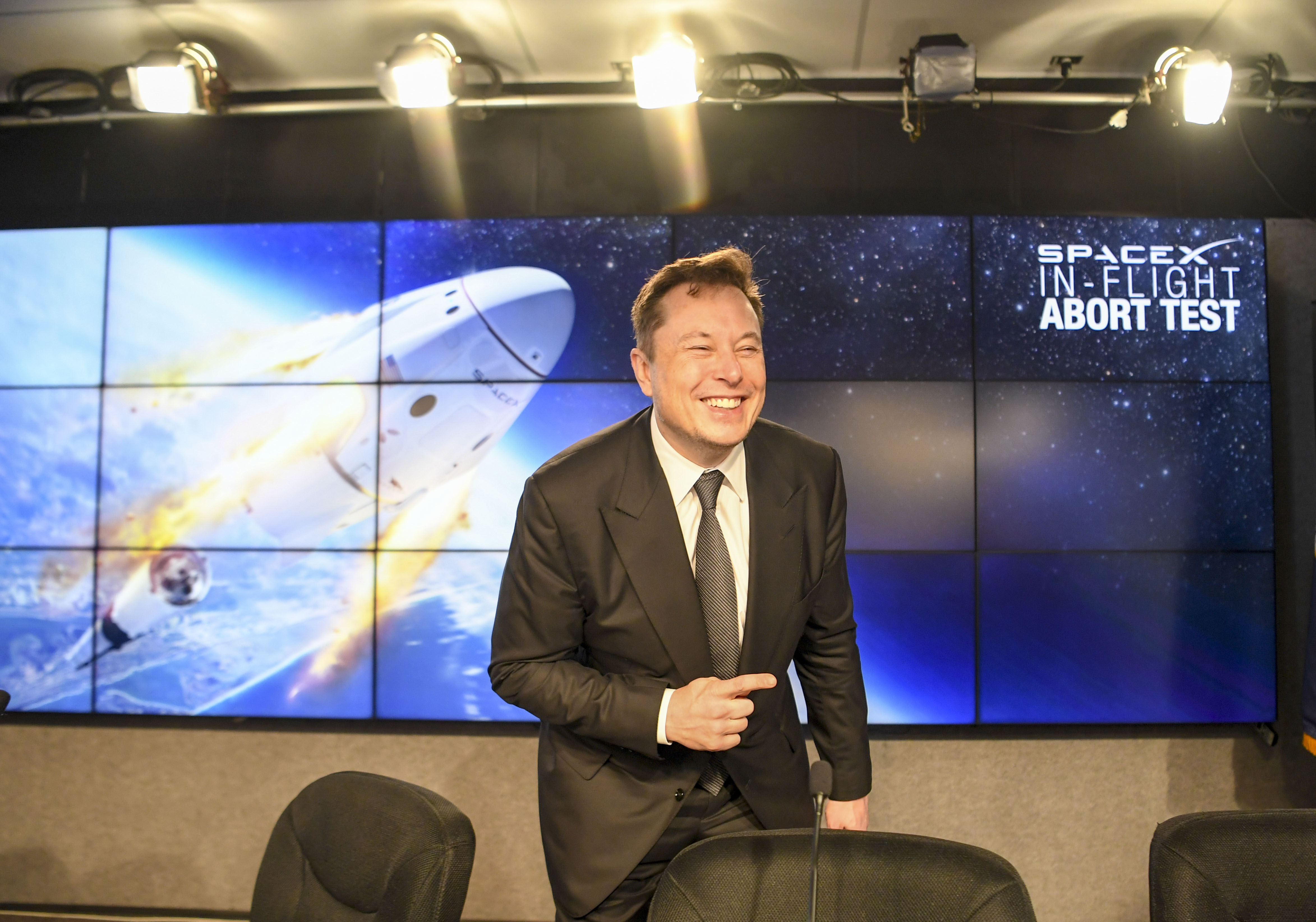 SpaceX CEO Elon Musk talks with reporters following a press conference after NASA and SpaceX's performed an in-flight abort test of the Crew Dragon capsule at NASA's Kennedy Space Center in Cape Canaveral, Fla., on Jan. 19, 2020. MUST CREDIT: Washington Post photo by Jonathan Newton