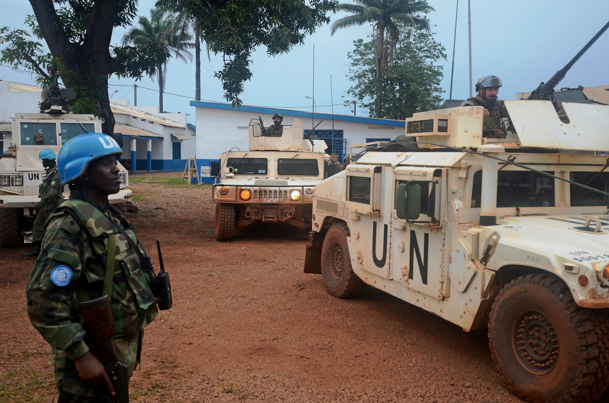 A U.N. soldier stands guard as a mixed UN military convoy of Portuguese special forces and Cameroonian and Mauritanian peacekeepers prepares to patrol the PK5 neighborhood in Bangui, Central African Republic, on Nov. 17, 2017. MUST CREDIT: Bloomberg photo by Pauline Bax.
