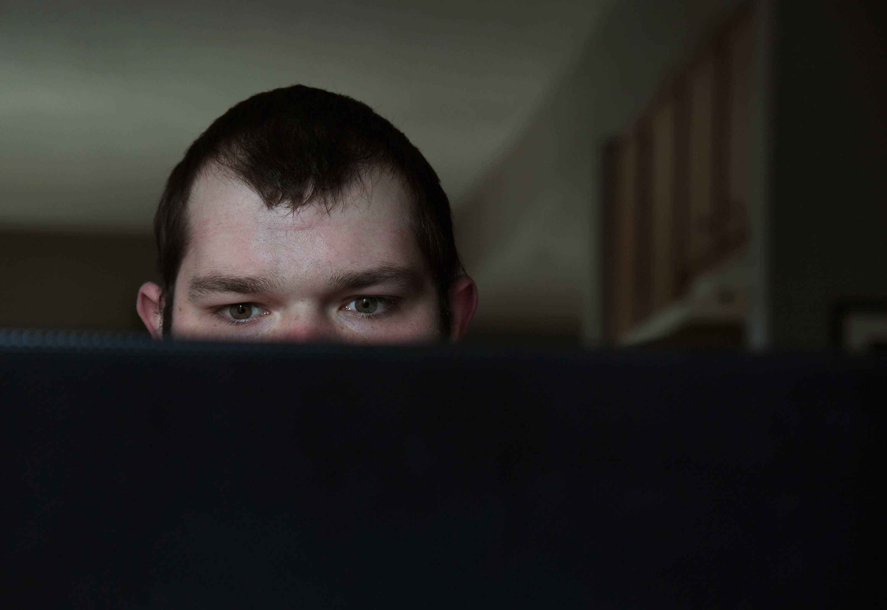 Kam Musser spends a lot of time on his computer at home outside Columbus, Ohio, watching videos of white nationalist rallies. Despite his mother's and grandmother's disapproval, he continues to tout his neo-Nazi views. MUST CREDIT: Washington Post photo by Michael S. Williamson.