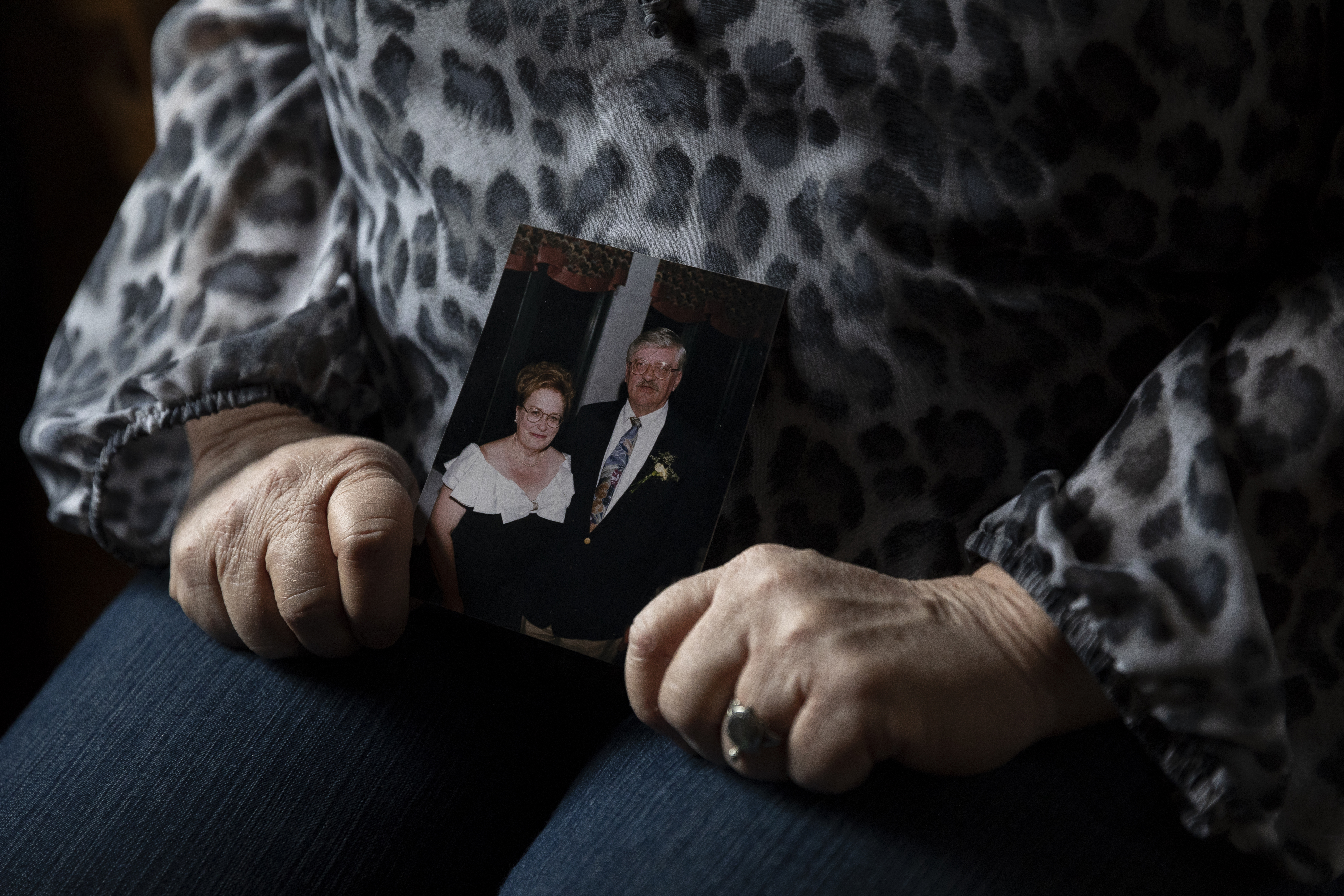 Janine Cooke, 53, holds a photo of her mother, Mary Catlin, and a friend at her home in Brighton, Mich. MUST CREDIT: Photo for The Washington Post by Elaine Cromie