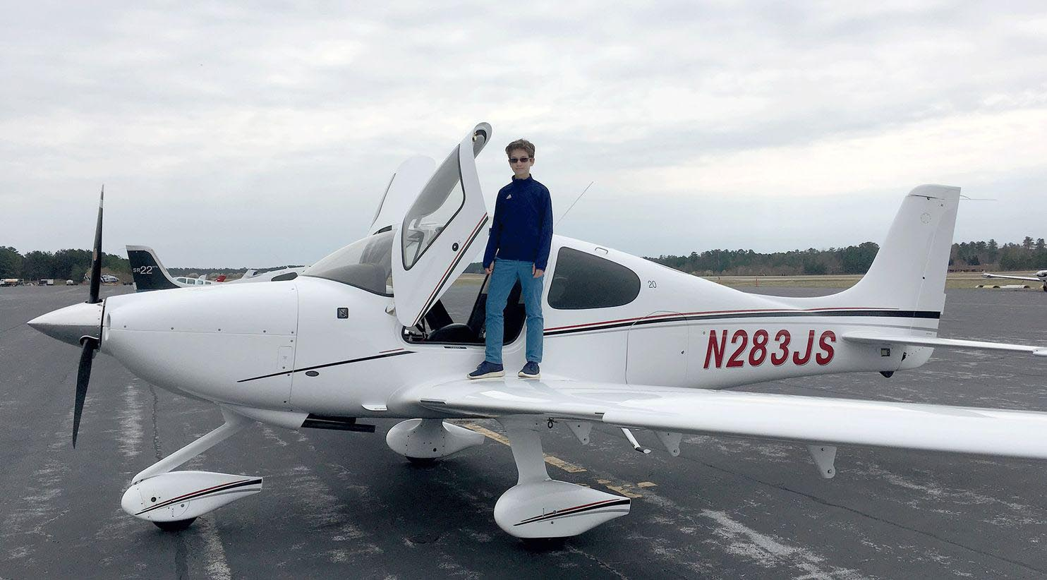 Cade Glass, 13, poses by a Cirrus SR20 airplane during a lesson at Chesterfield County Airport near Richmond, Va., in March. Glass has wanted to be a pilot since at least 7. MUST CREDIT: Scott Glass