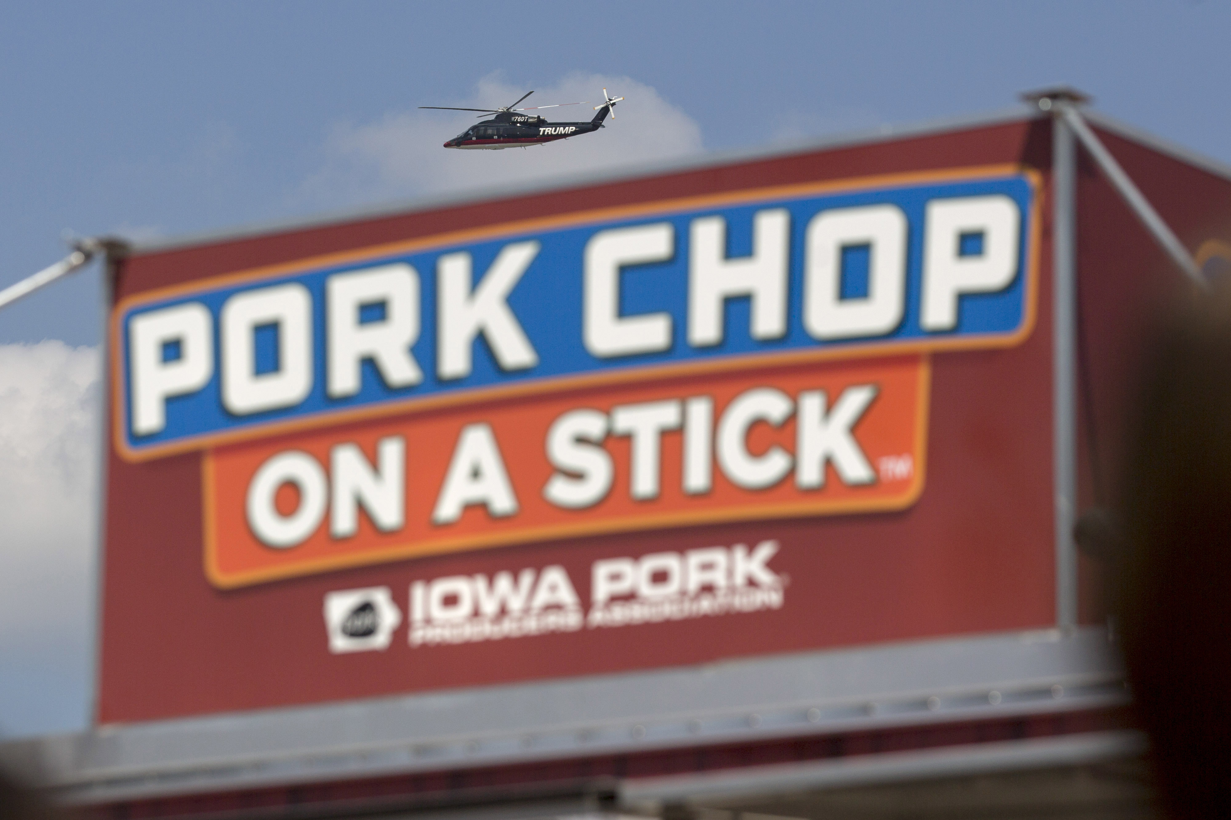 The helicopter of Donald Trump flies over a pork chop on a stick stand at the Iowa State Fair in Des Moines, Iowa, on Aug. 15, 2015. MUST CREDIT: Bloomberg photo by Andrew Harrer.