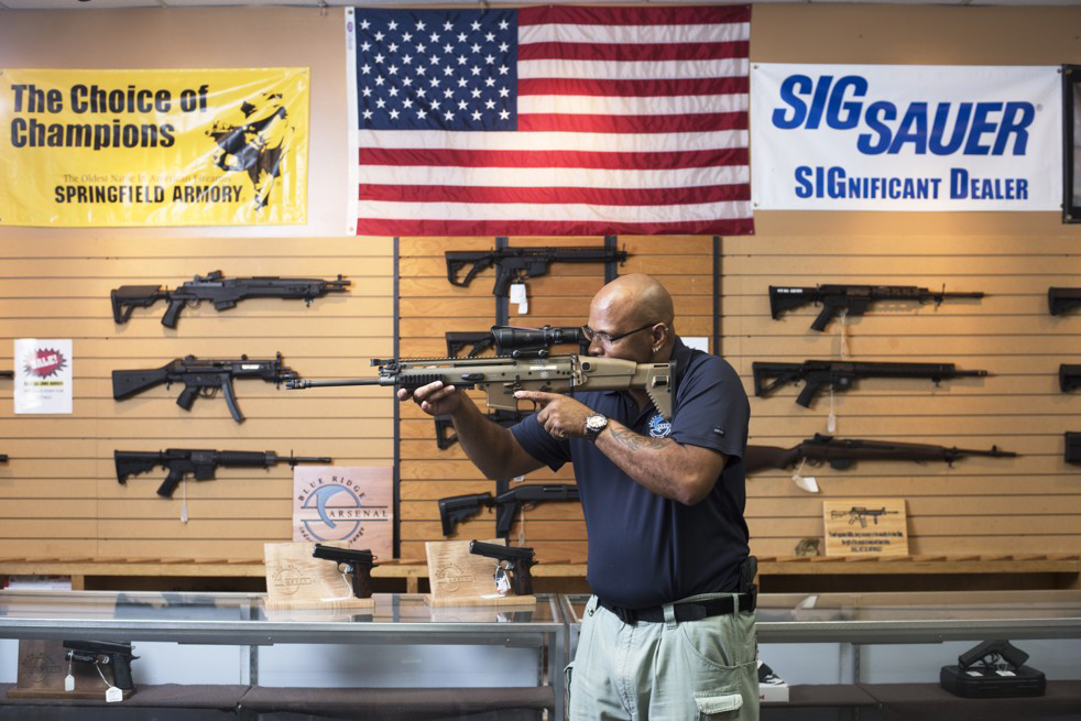 Mark Warner has worked at Blue Ridge Arsenal, a black-owned gun store in Chantilly, Va. for 18 years.