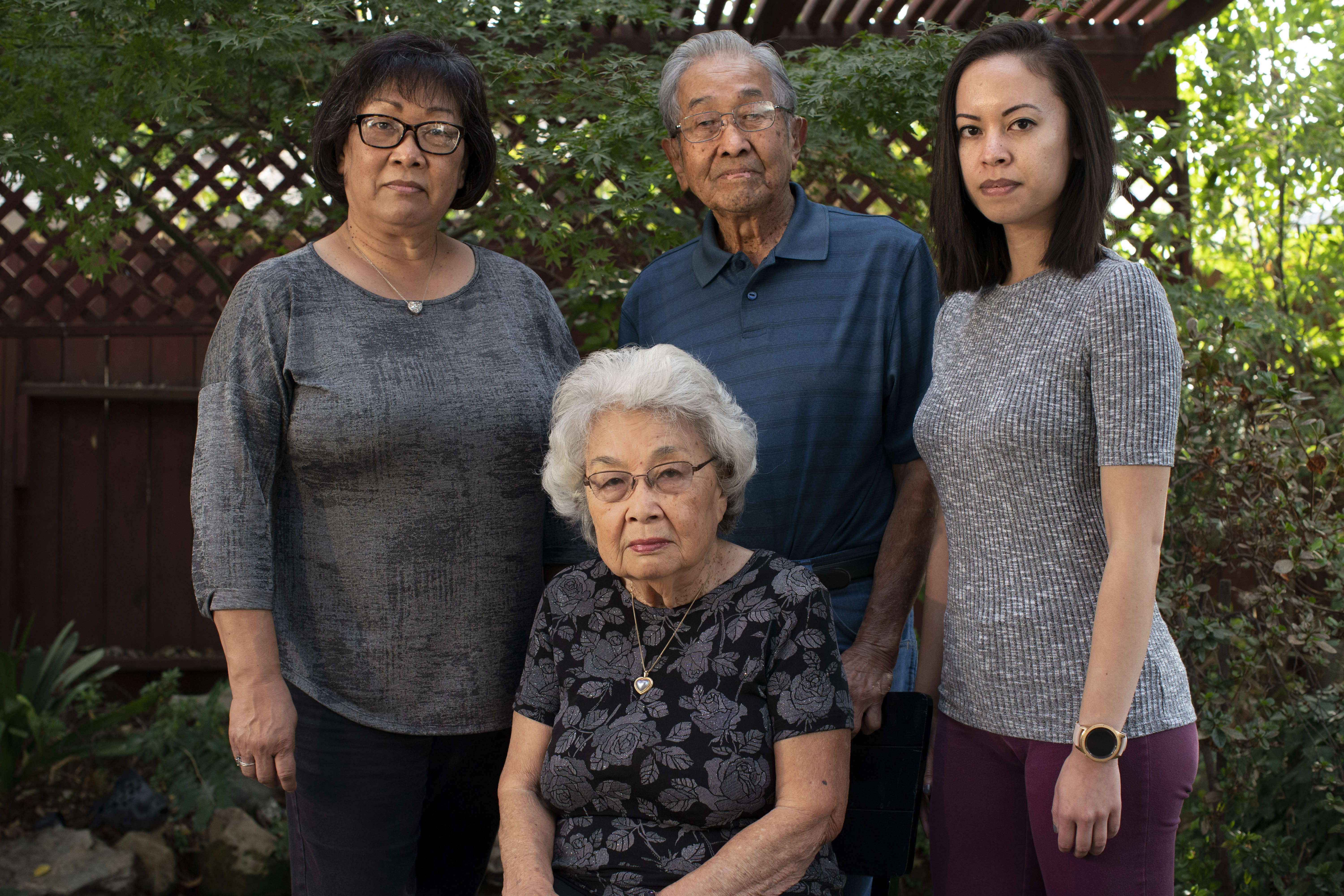 Ginny Yamamoto stands with her parents Mitsuo Yamamoto and Jayne Yamamoto, and along with her daughter Robyn Syphax within their Japanese garden in Sacramento, California. MUST CREDIT: Washington Post photo by Melina Mara.