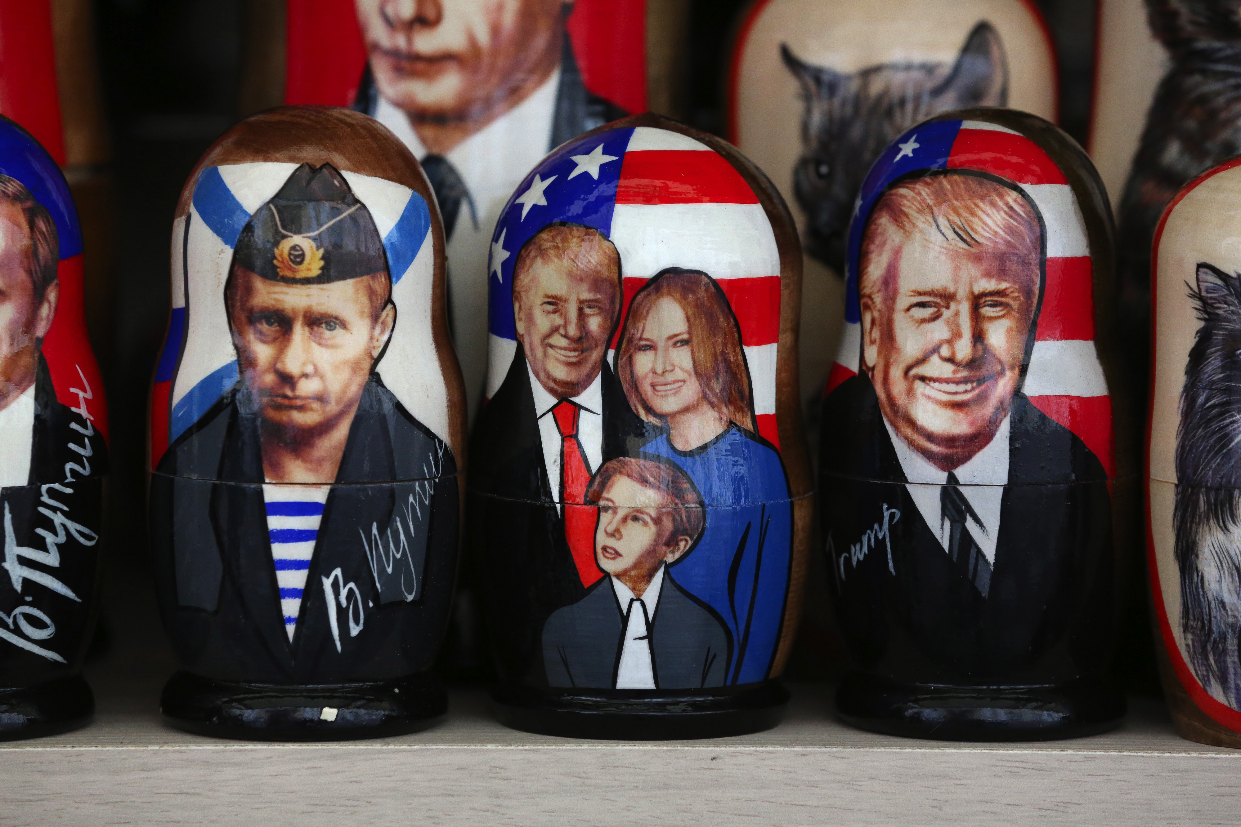 Souvenir matryoshka dolls depicting Vladimir Putin, Russia's president, left, and President Donald Trump and his family sit on display at a tourist stall in the city center ahead of the St. Petersburg International Economic Forum in Saint Petersburg, Russia, on May 31, 2017. Photograph MUST CREDIT: Bloomberg photo by Andrey Rudakov