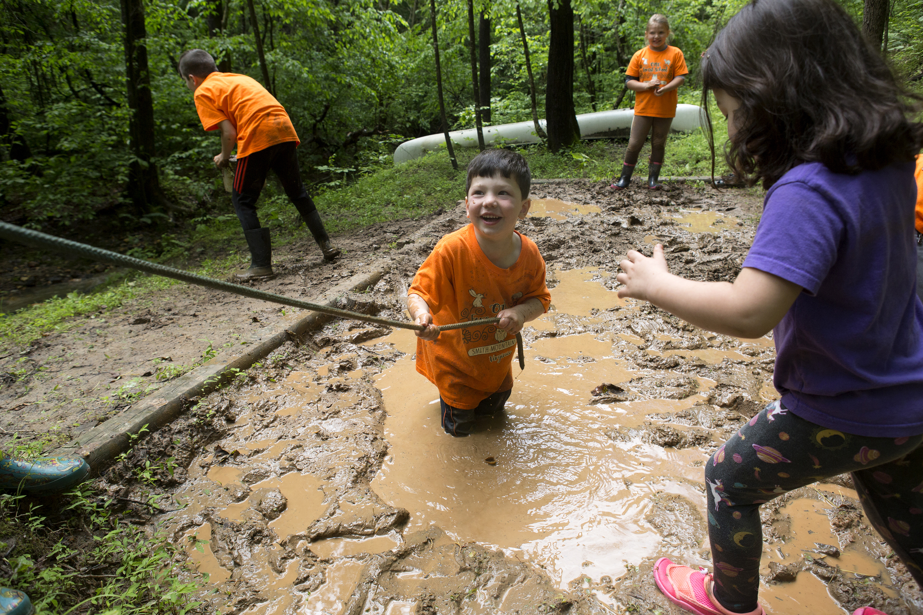 Isaiah Reilly, 4, plays in the mud pit at ONE Forest School in Huddleston, Va., last week The outdoor school is staying open during the pandemic. MUST CREDIT: photo for The Washington Post by Heather Rousseau.