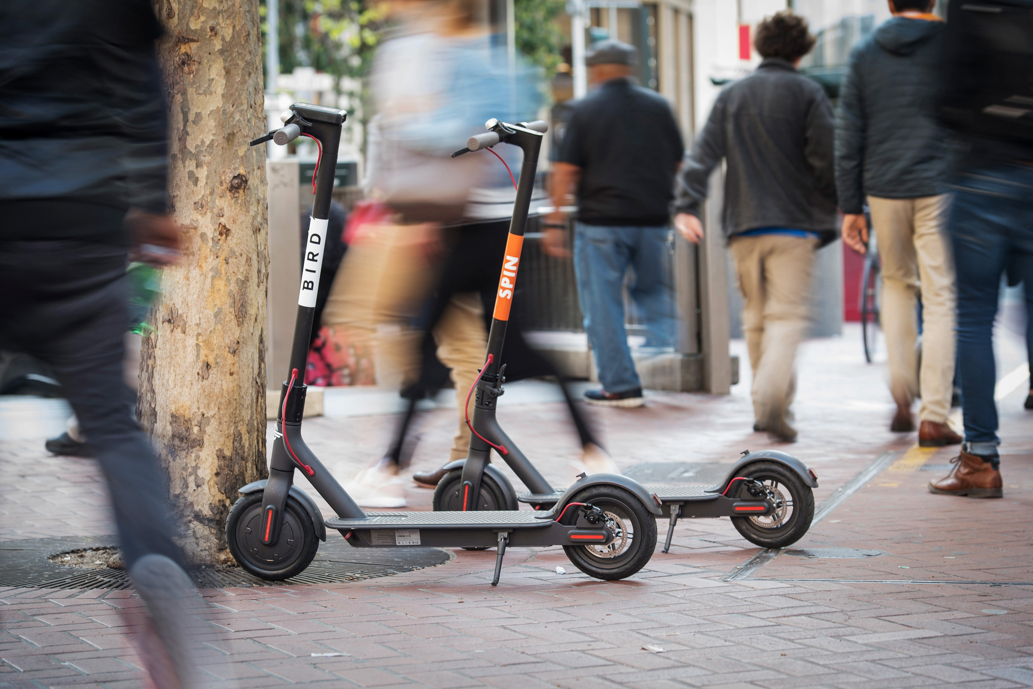 Motorized scooters, like these from Bird and Spin, have been showing up in cities around the U.S. MUST CREDIT: Bloomberg photo by David Paul Morris