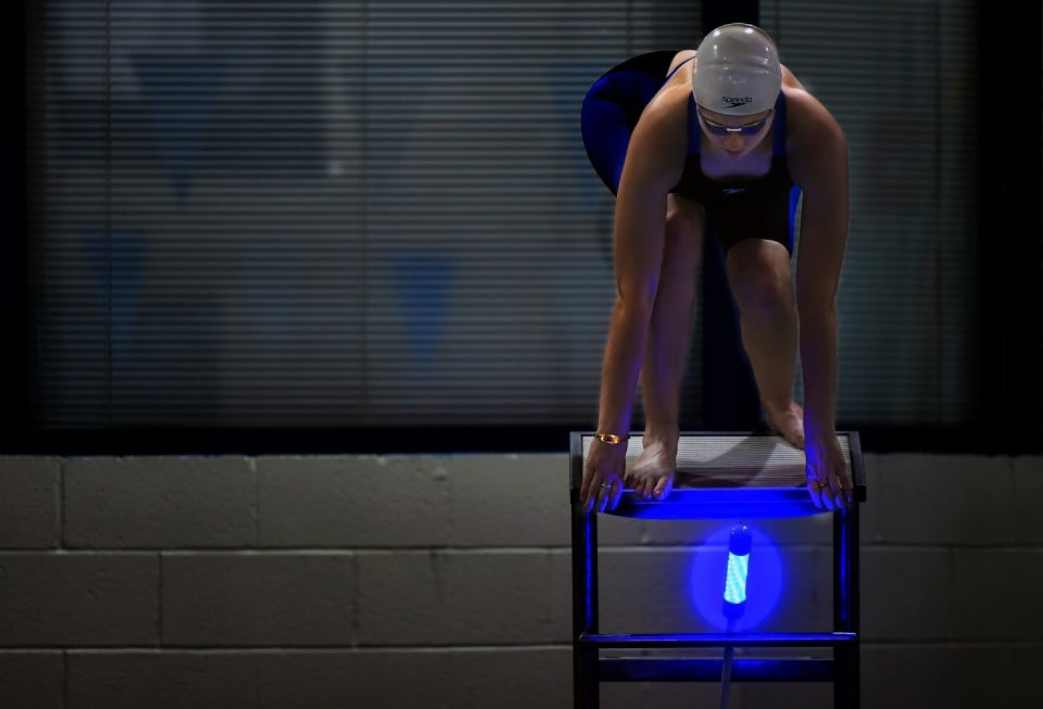 Gallaudet swimmer Faye Frex-Albrecht takes her mark on a starting block outfitted with a Reaction Light System, which helps level the field between hearing and non-hearing competitors. MUST CREDIT: Washington Post photo by Katherine Frey.