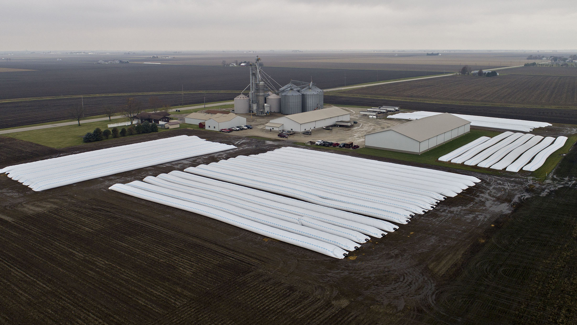 Bags of corn and soybeans sit in rows at Gingerich Farms in this aerial photograph taken over Lovington, Ill., on Nov. 9, 2018. MUST CREDIT: Bloomberg photo by Daniel Acker.