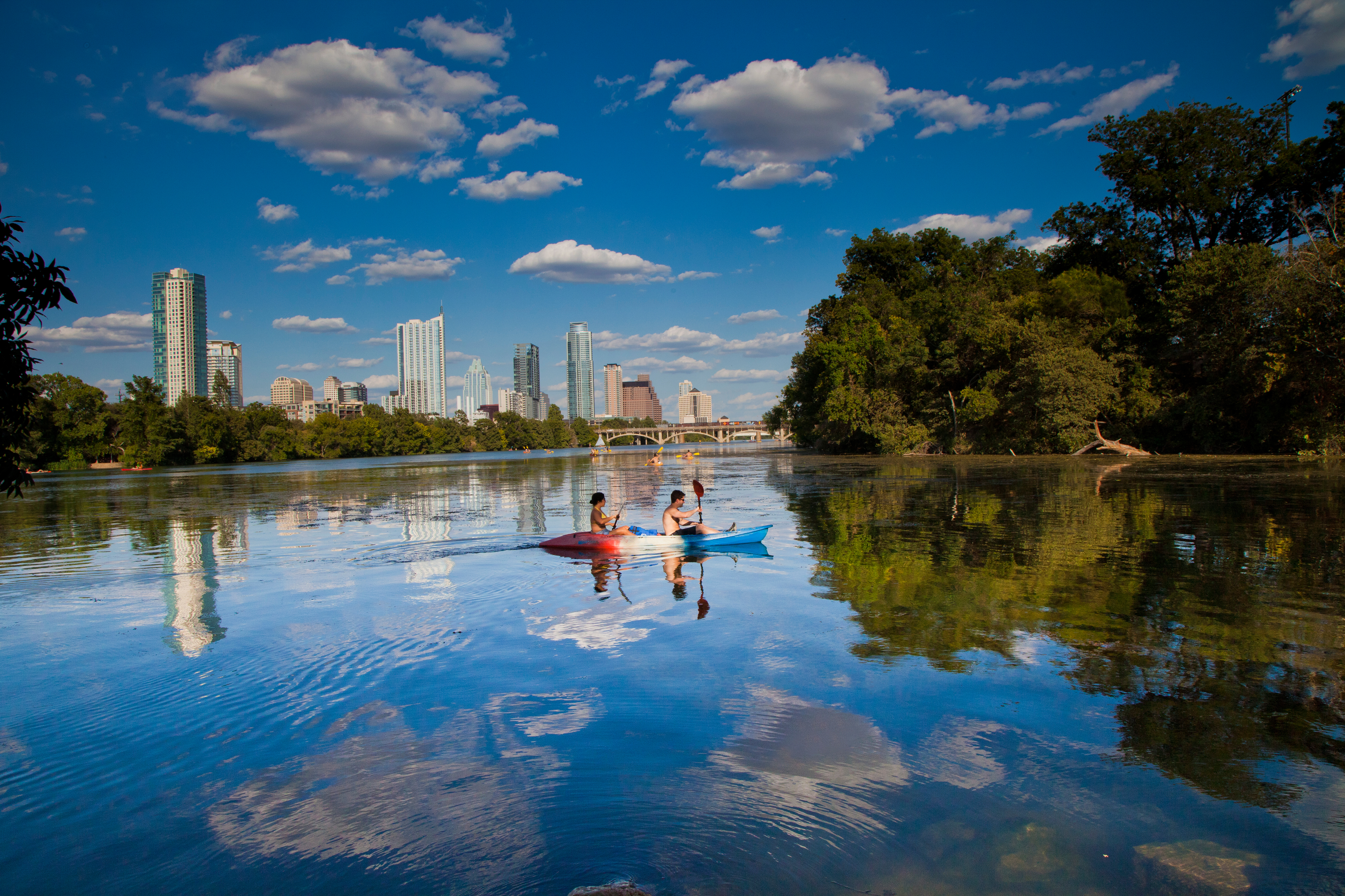 Kayakers take in the skyline from Lady Bird Lake, which is encircled by a hiking-and-biking trail that stretches more than 10 miles. MUST CREDIT: Austin Convention & Visitors Bureau.