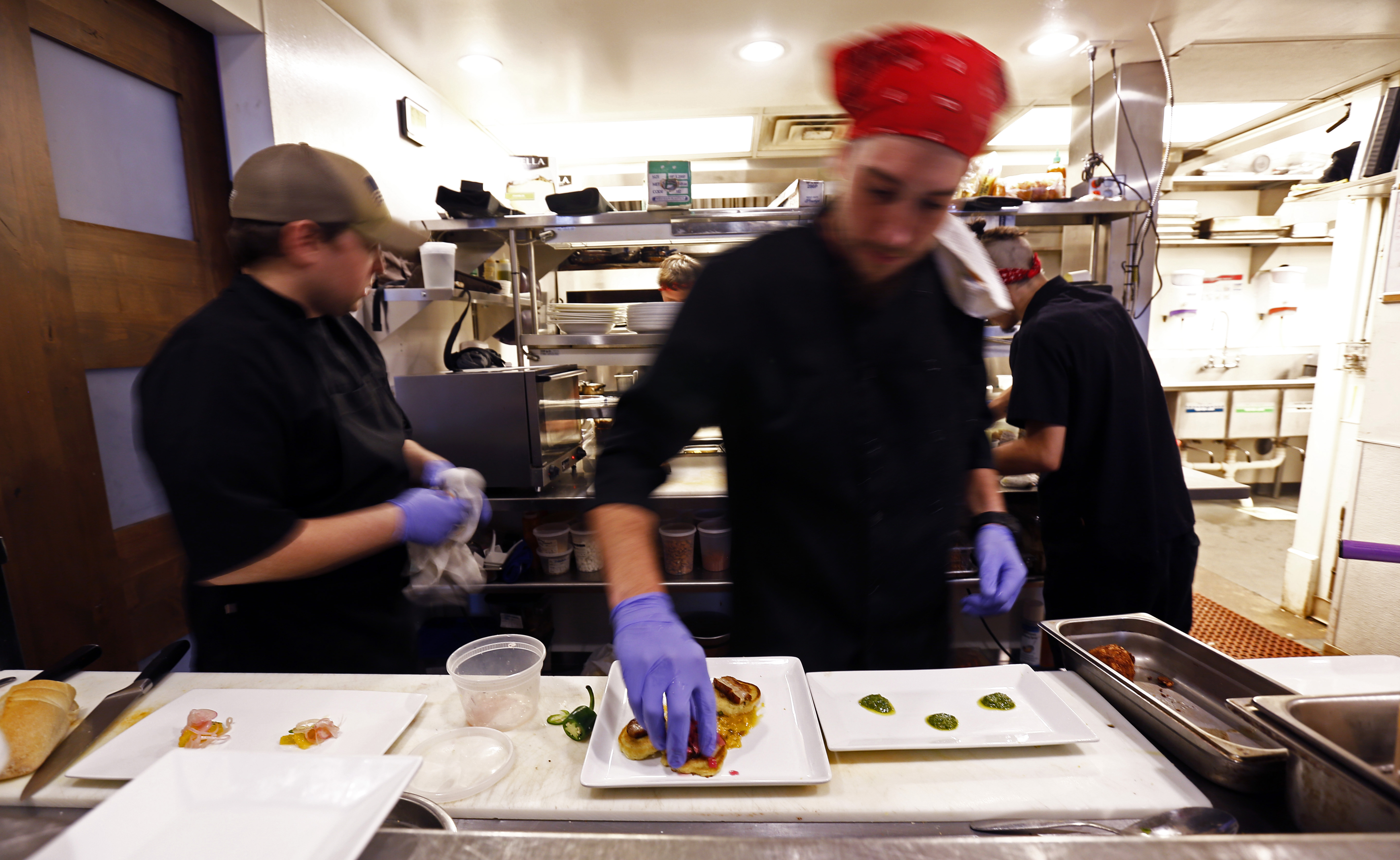 One of the chef's at The Dwell Hotel prepares a plate. MUST CREDIT: Photo by Wade Payne for The Washington Post.