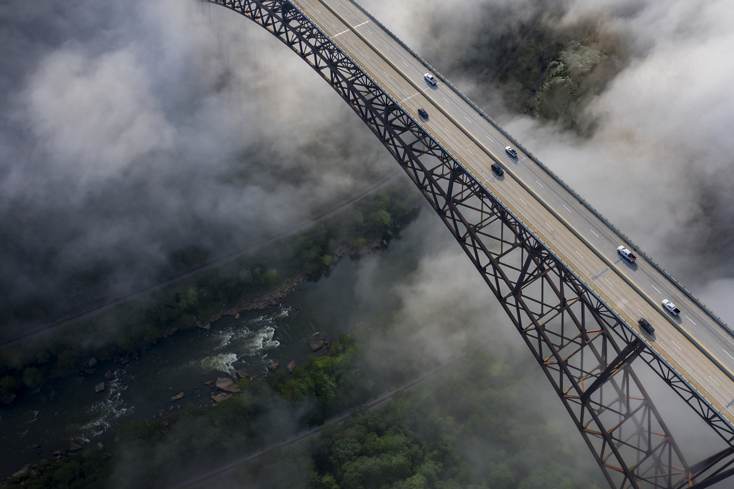 The New River Gorge Bridge spans the canyon 876 feet above the river. Hiking and mountain biking trails and railroad tracks cross the rugged Appalachian forest surrounding the gorge. MUST CREDIT: Jay Young/Adventures on the Gorge