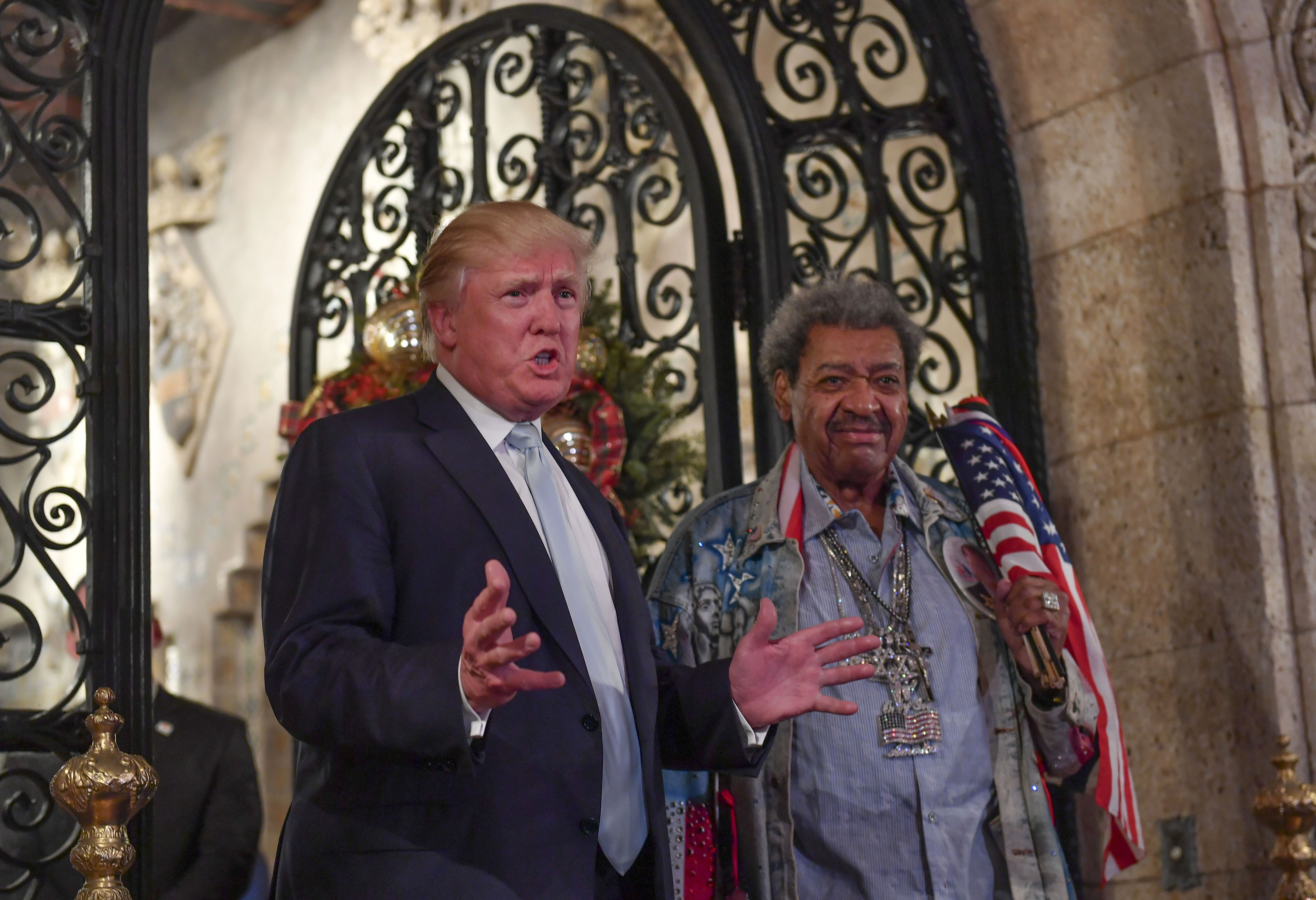 President-elect Donald Trump and fight promoter Don King address the media in December 2016 in Palm Beach, Fla. MUST CREDIT: Washington Post photo by Ricky Cariot