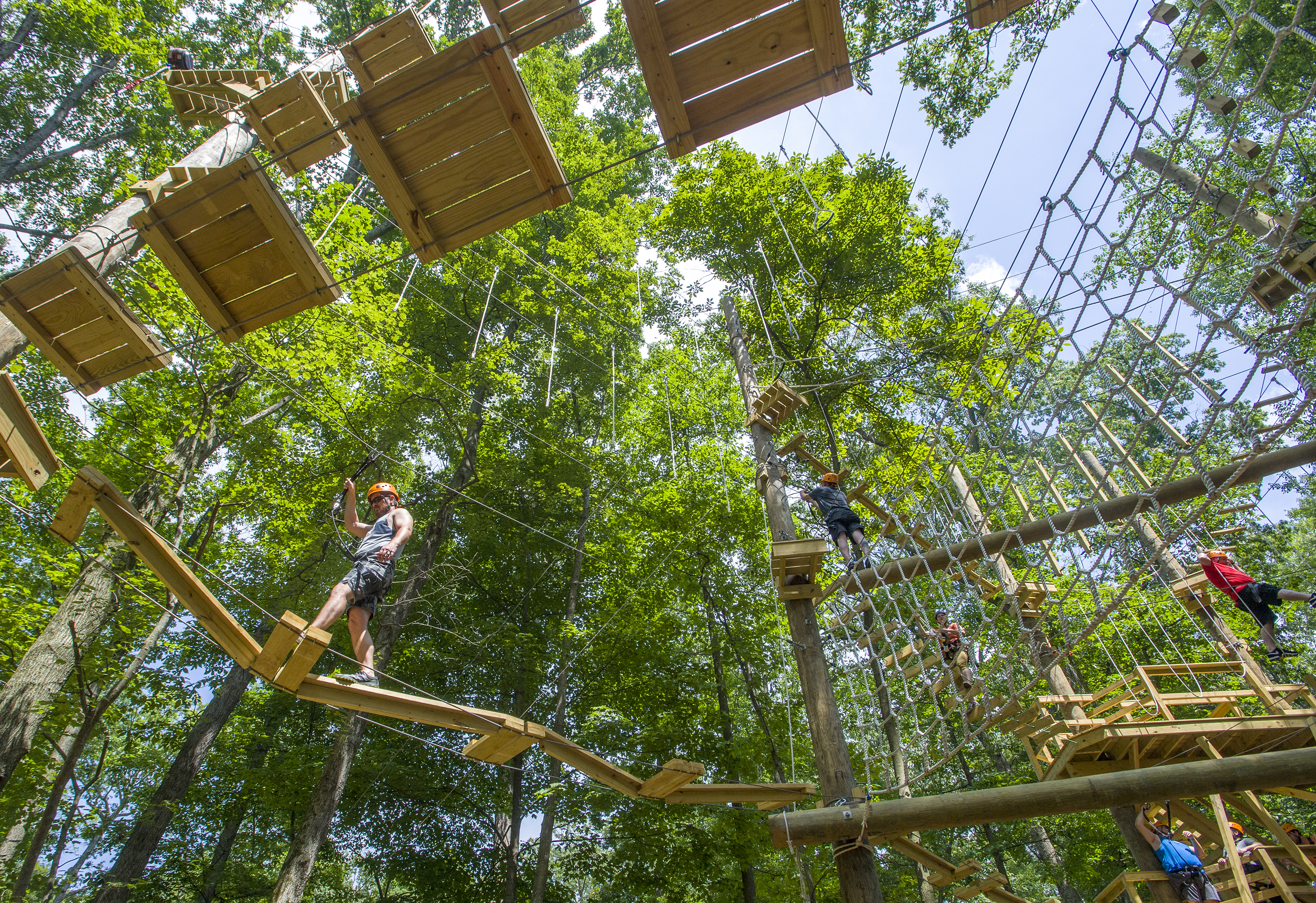 Veteran Chad Stuehlmeyer, left, of Mt. Vernon, Ill., one of the participants in Project Sanctuary, navigates the ropes course at the Pearlstone Center in Reisterstown, Md. MUST CREDIT: Photo for The Washington Post by Doug Kapustin