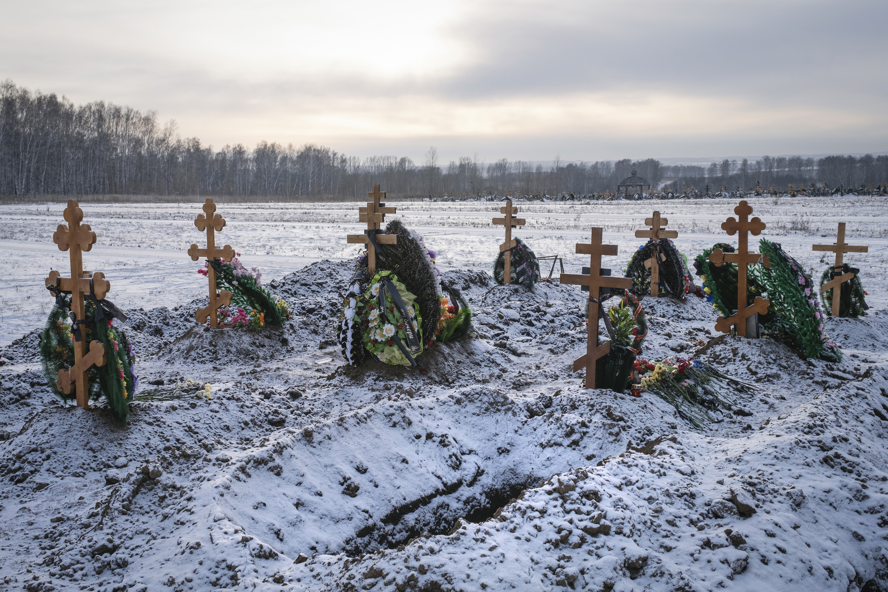 Fresh graves at a cemetery Nov. 15 in Kemerovo, Russia. MUST CREDIT: photo for The Washington Post by Arthur Bondar.