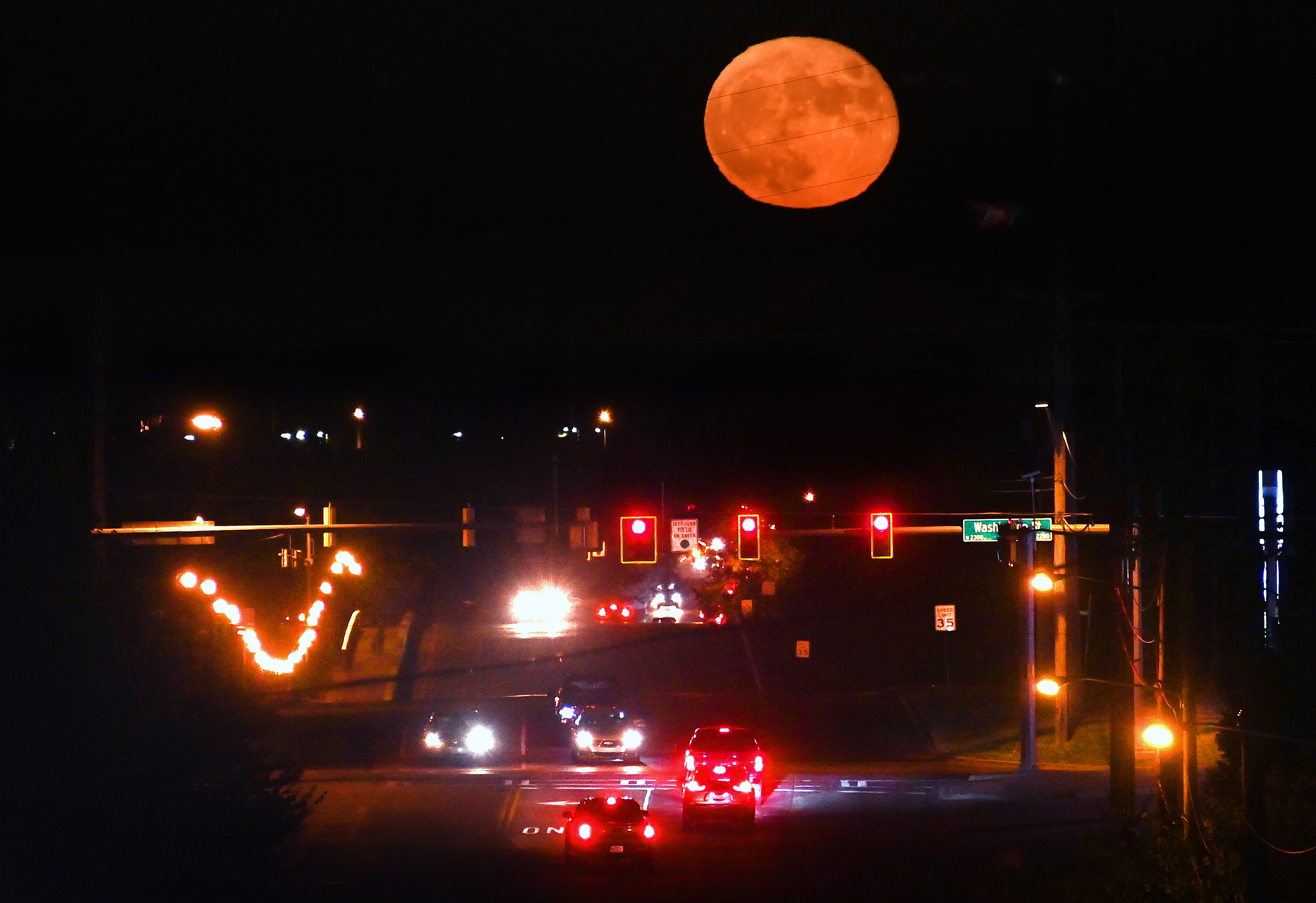 A nearly full moon rises over the main drag that leads to Stillwater Medical Center in Stillwater, Okla., Sept.21, 2021. MUST CREDIT: Washington Post photo by Michael S. Williamson