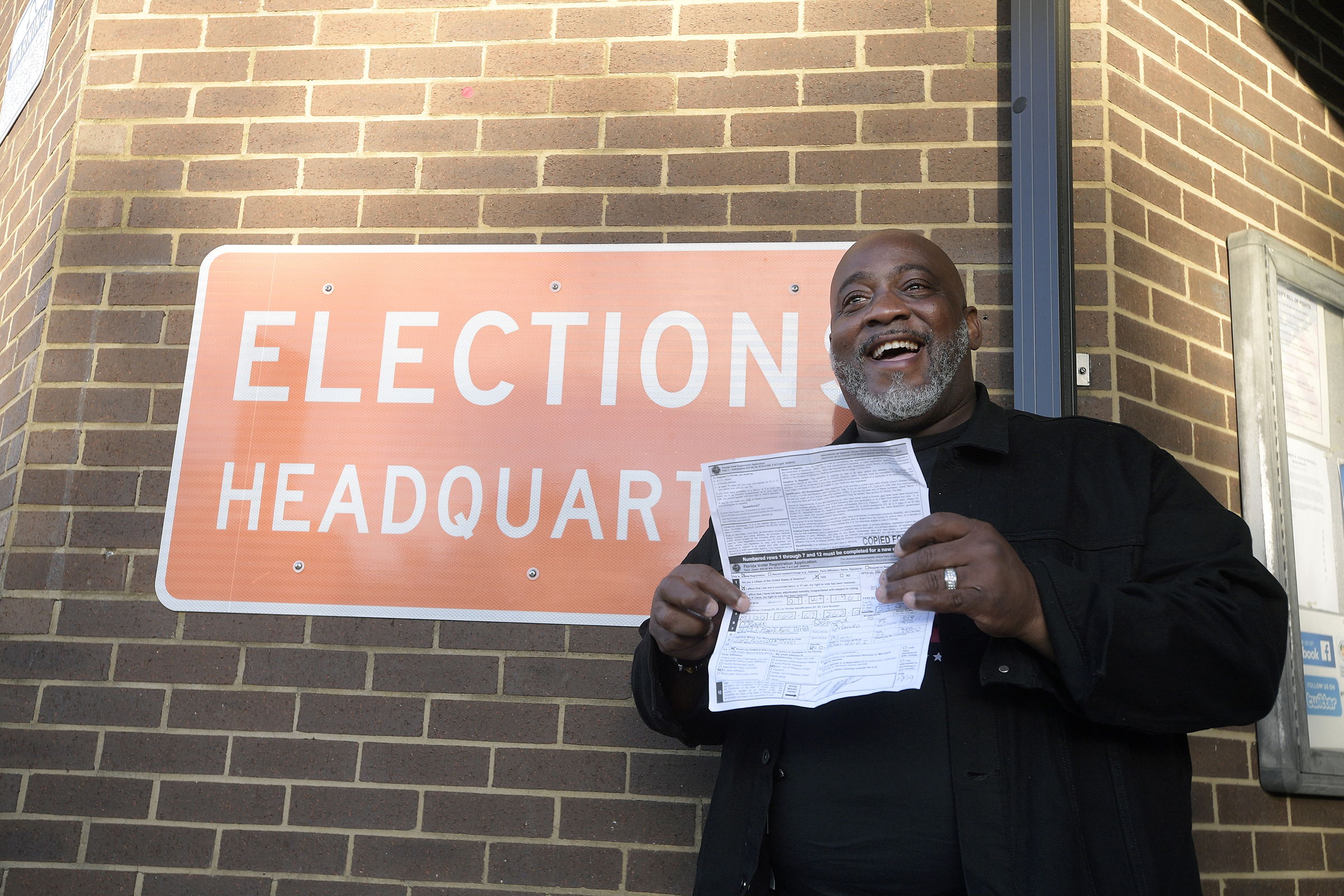Desmond Meade displays a copy of his voter registration form outside the Orange County Supervisor of Elections office in Orlando on Jan. 8, 2019, after registering to vote. MUST CREDIT: Photo for The Washington Post by Phelan M. Ebenhack